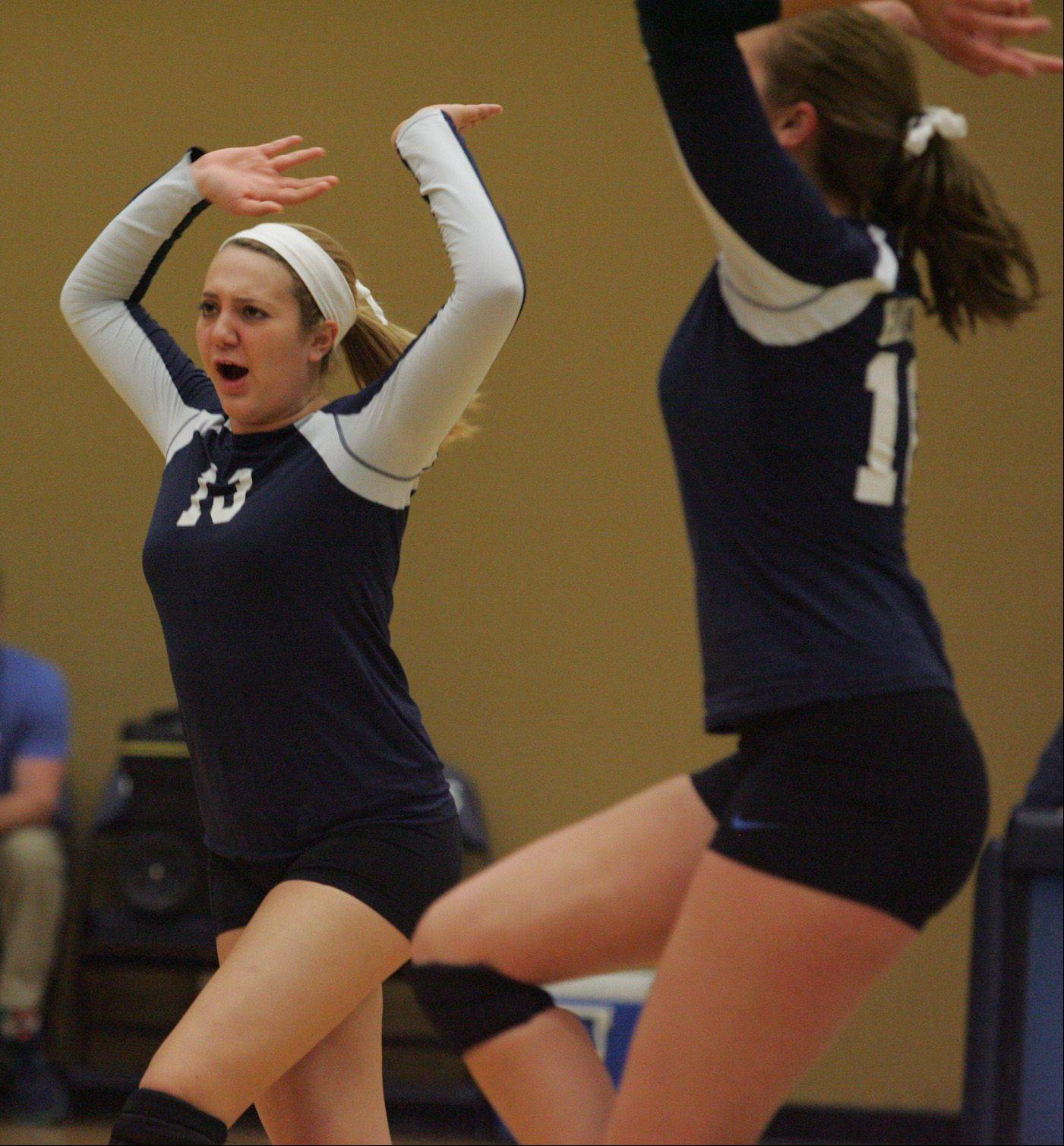 Harvest Christian teammates Erica Manusos, left, and Sydney Doby celebrate a point Thursday night.