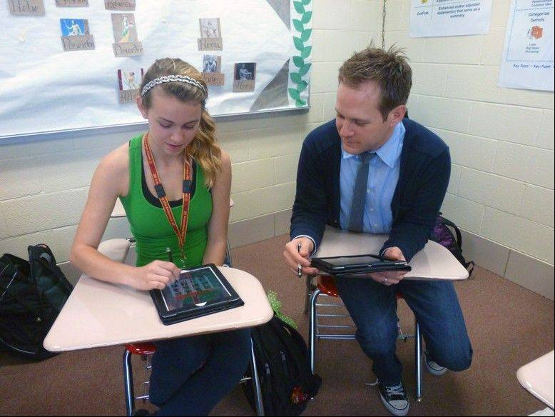 Curtin works with student Justyna Niechwiej during Freshman Honors English.