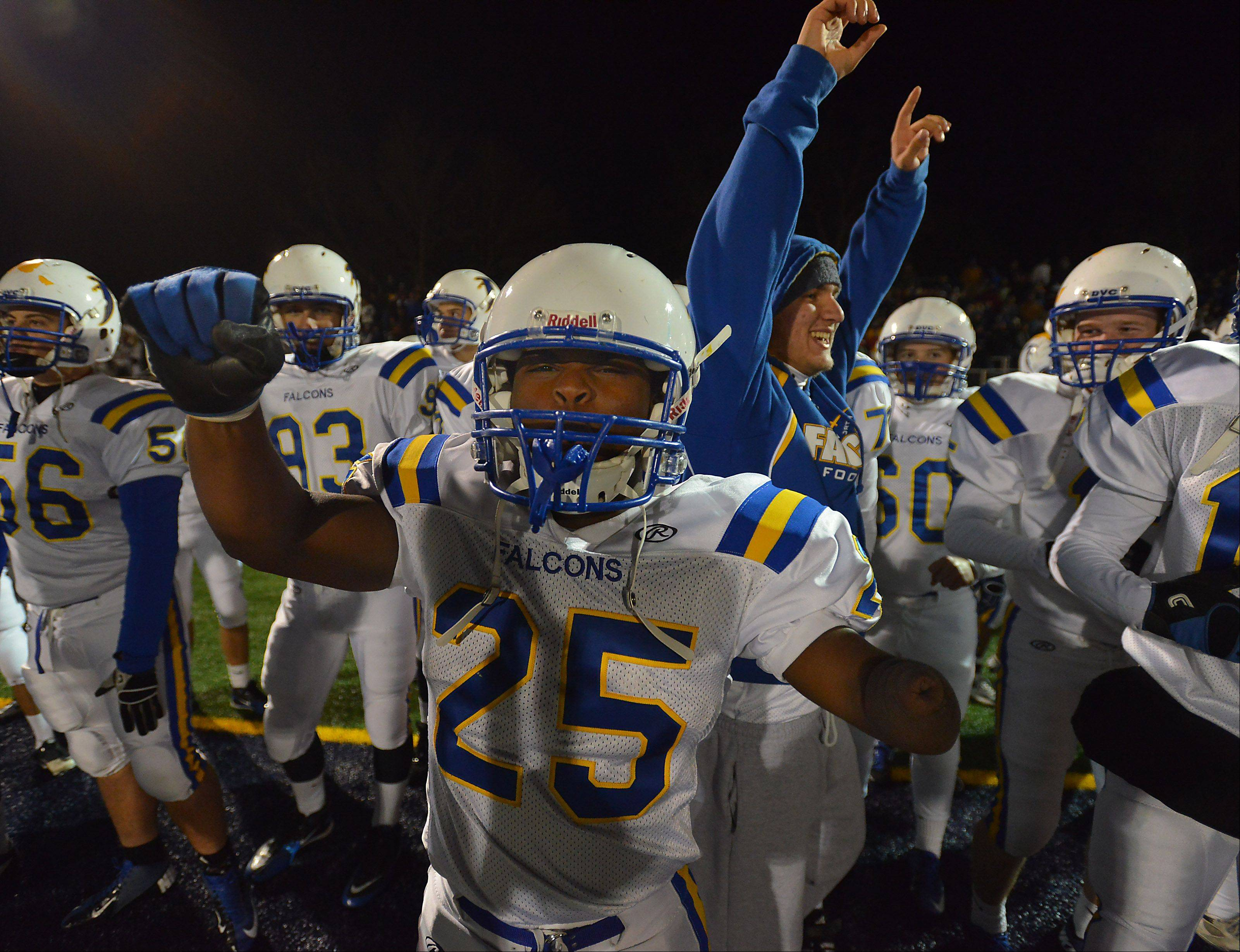 Wheaton North's Lataye Smith celebrates with his teammates in the four quarter with only seconds left as the Falcons top Prospect in the second round of the Class 7A playoffs Friday night in Mt. Prospect.