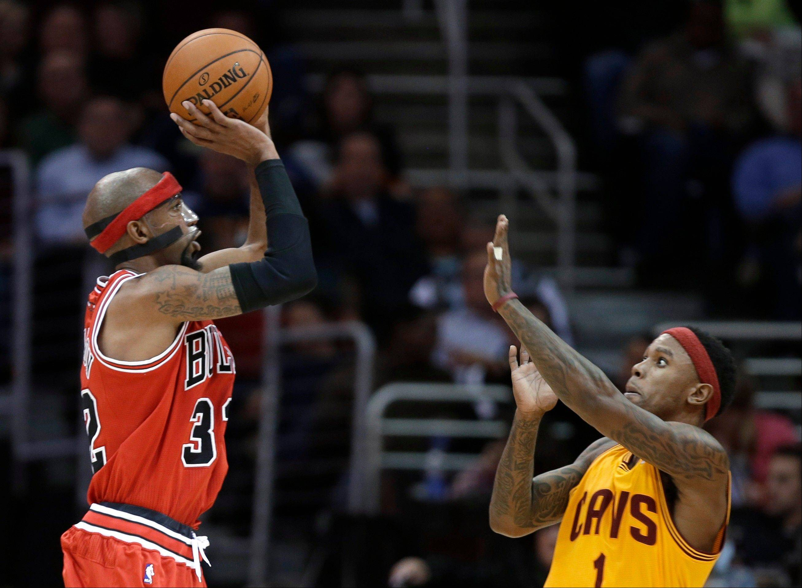 Richard Hamilton shoots over Cleveland�s Daniel Gibson during the third quarter of the Bulls� victory Friday night in Cleveland.