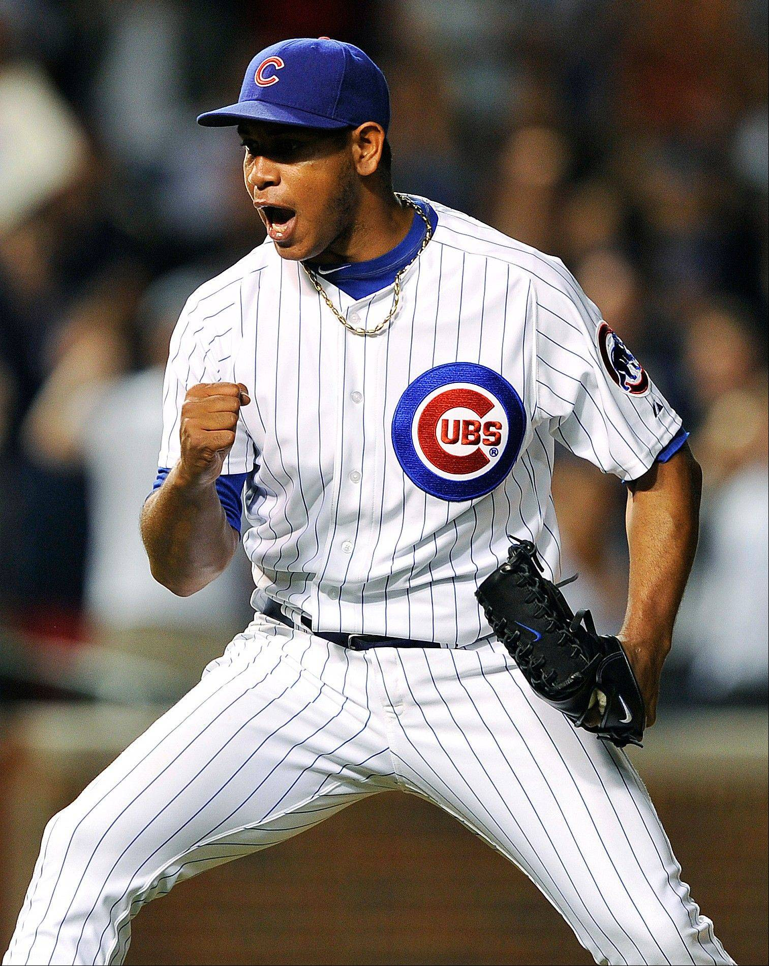 Carlos Marmol celebrates their 5-3 win over the New York Mets after a baseball game, Tuesday, June 26, 2012, in Chicago.
