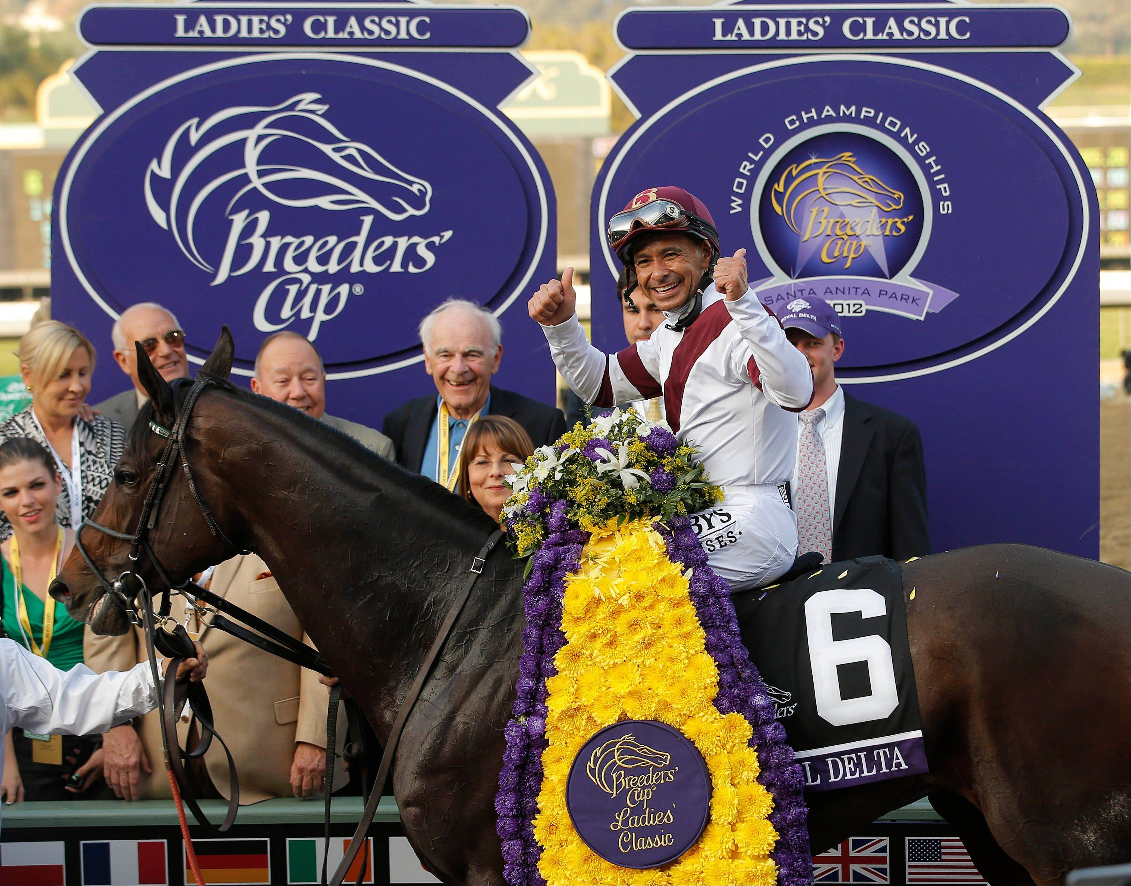 Jockey Mike Smith and Royal Delta led all the way Friday to win Breeders� Cup Ladies� Classic at Santa Anita.