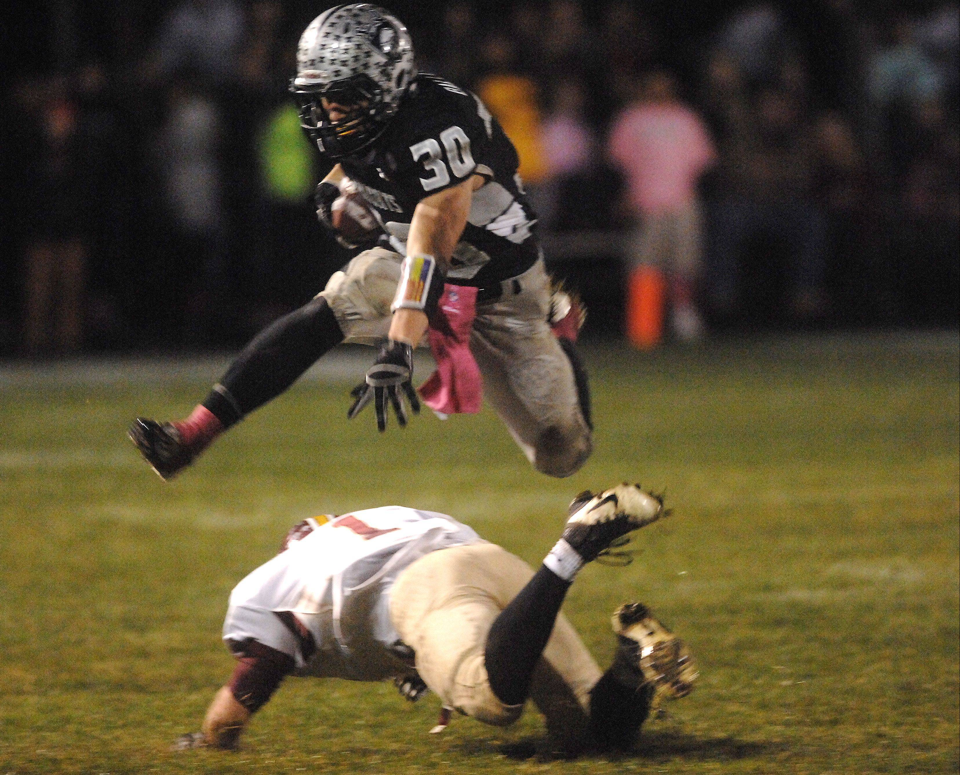 Kaneland�s Jesse Balluff, pictured hurdling a would-be Morris tackler last month, will be a key part of the Knights� game plan at Lincoln-Way West Saturday.