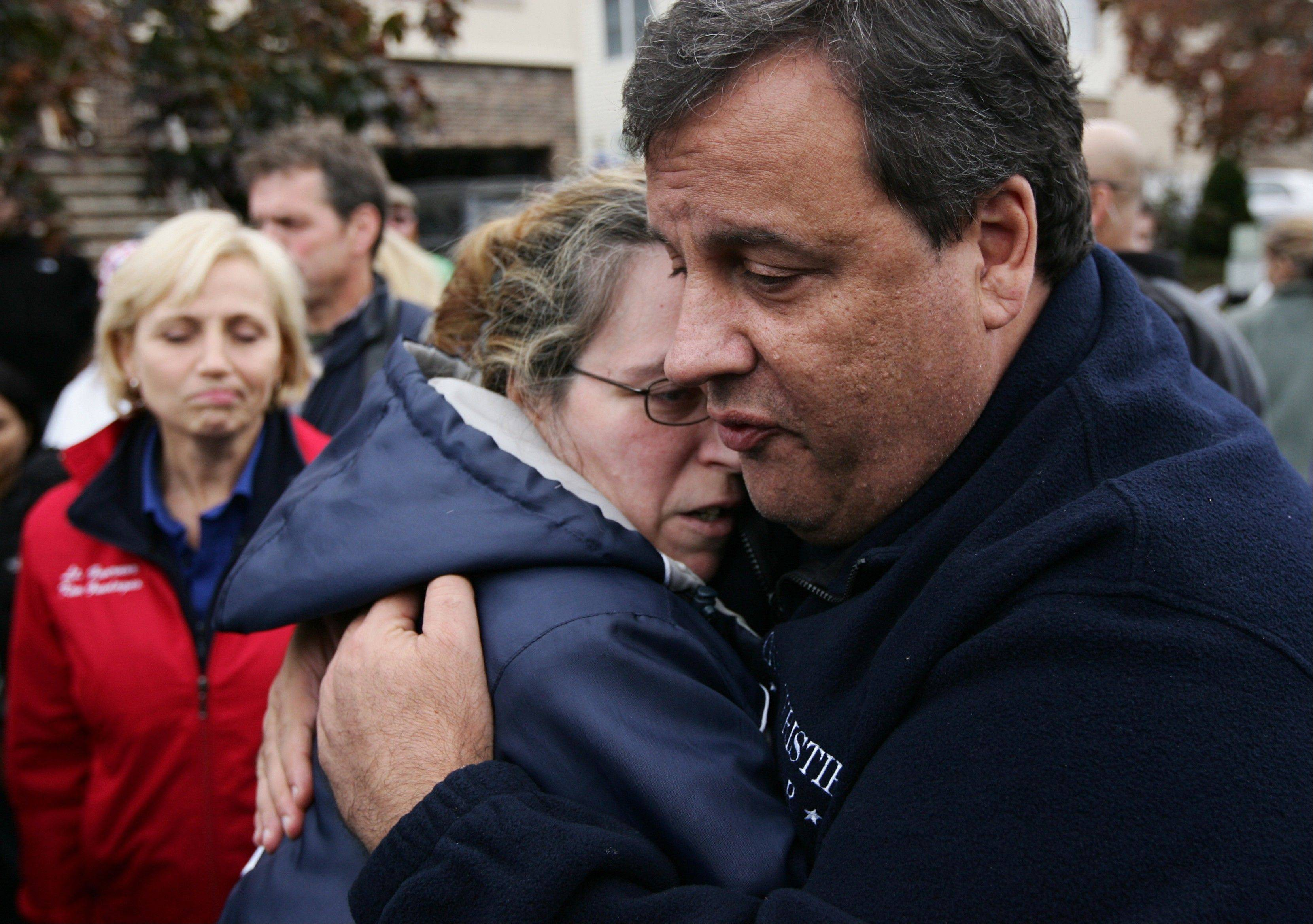 New Jersey Gov. Chris Christie tries to comfort Alice Cimillo Thursday and other Moonachie, N.J. residents whose homes were damaged by Superstorm Sandy, during a tour of the flood-ravaged area.