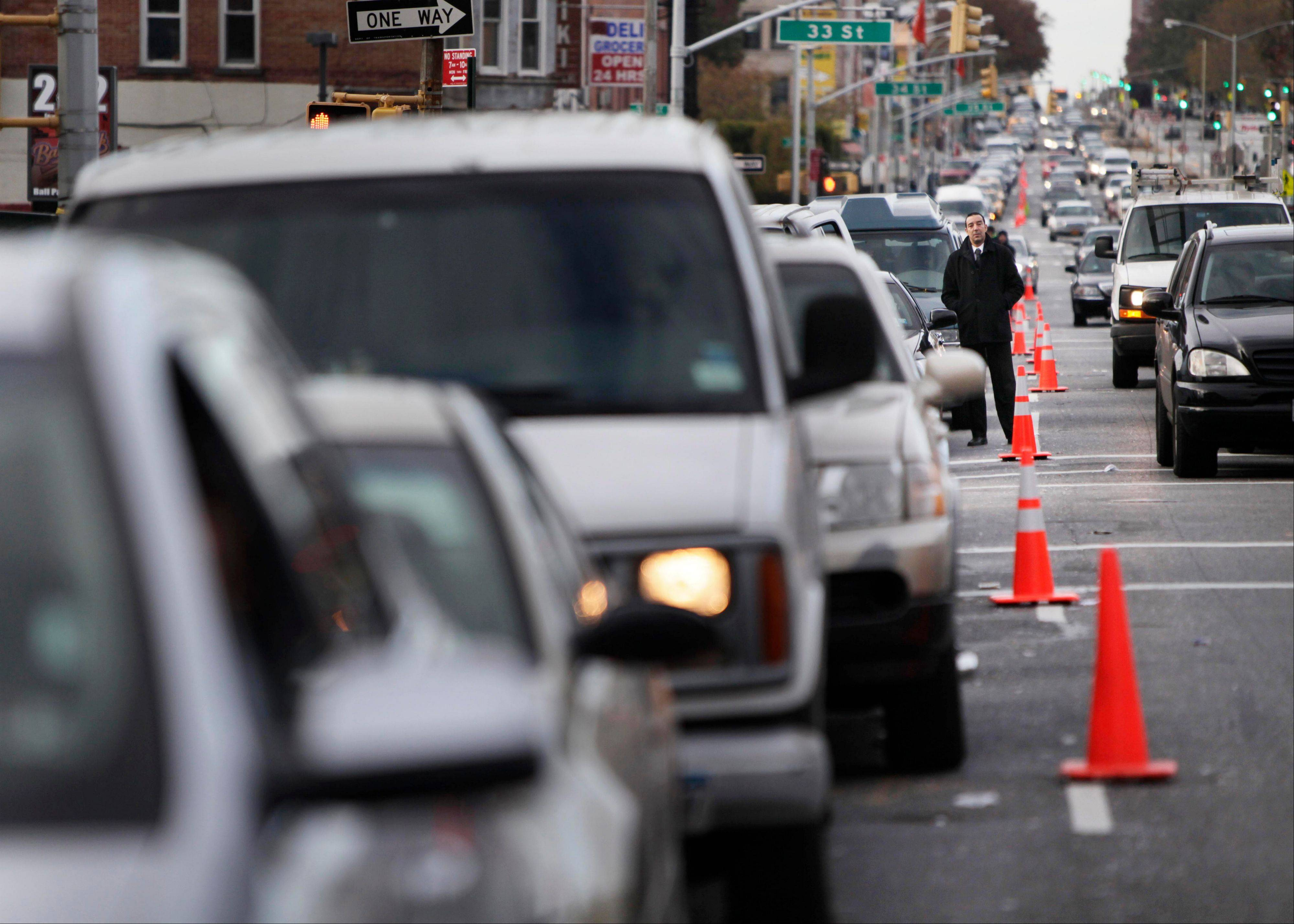 Cars wait for gas in a line that stretches Friday about one and a half miles in Brooklyn. Superstorm Sandy damaged ports that accept fuel tankers and flooded underground equipment that sends fuel through pipelines.