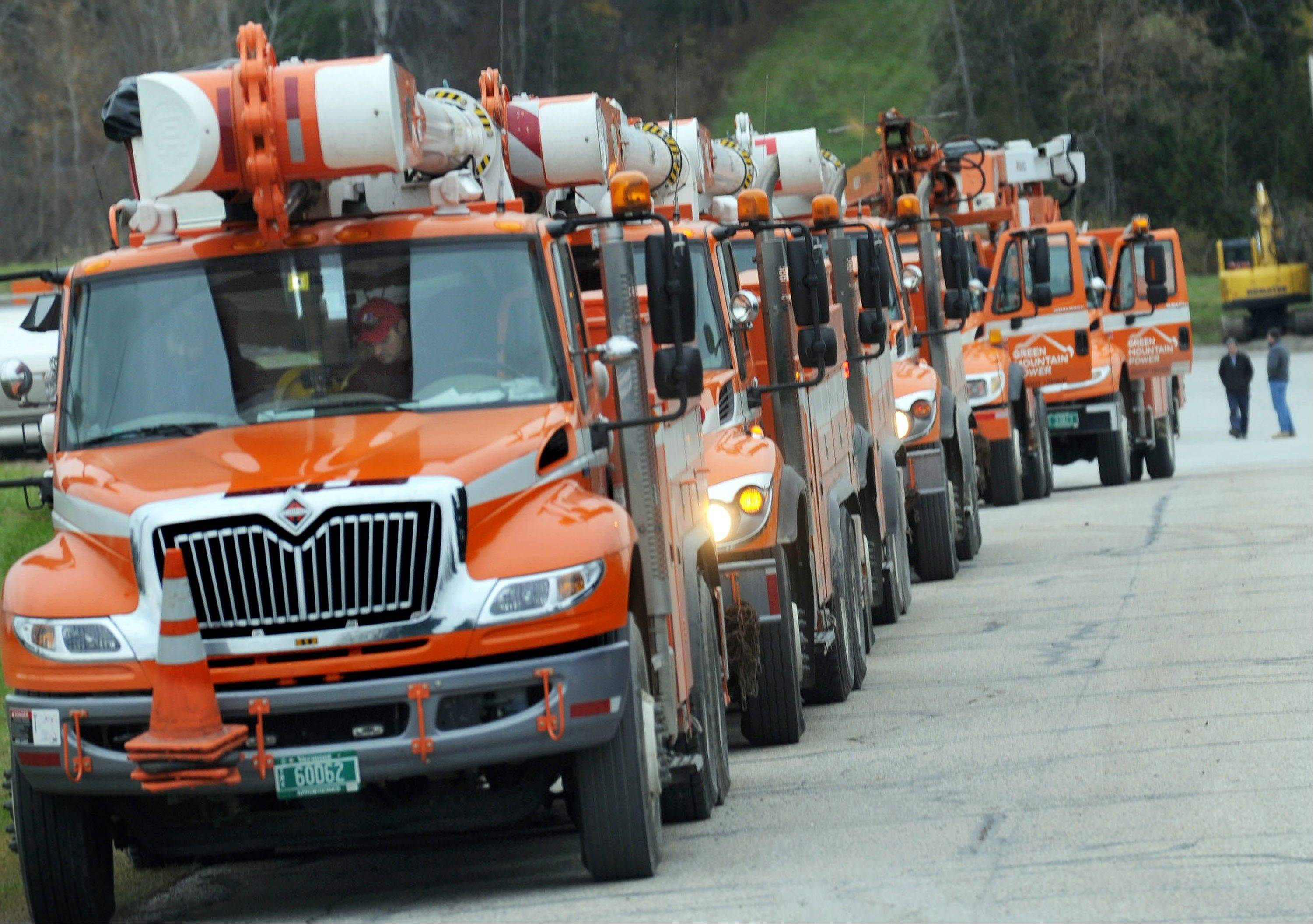 Green Mountain Power trucks line up Thursday to leave for Connecticut, in Rutland, Vt., to help with recovery efforts due to the damage caused by Superstorm Sandy. After Tropical Storm Irene caused widespread flooding in Vermont in 2011, volunteers and money poured in from around the country to help with the recovery. Now Vermont is returning the favor.