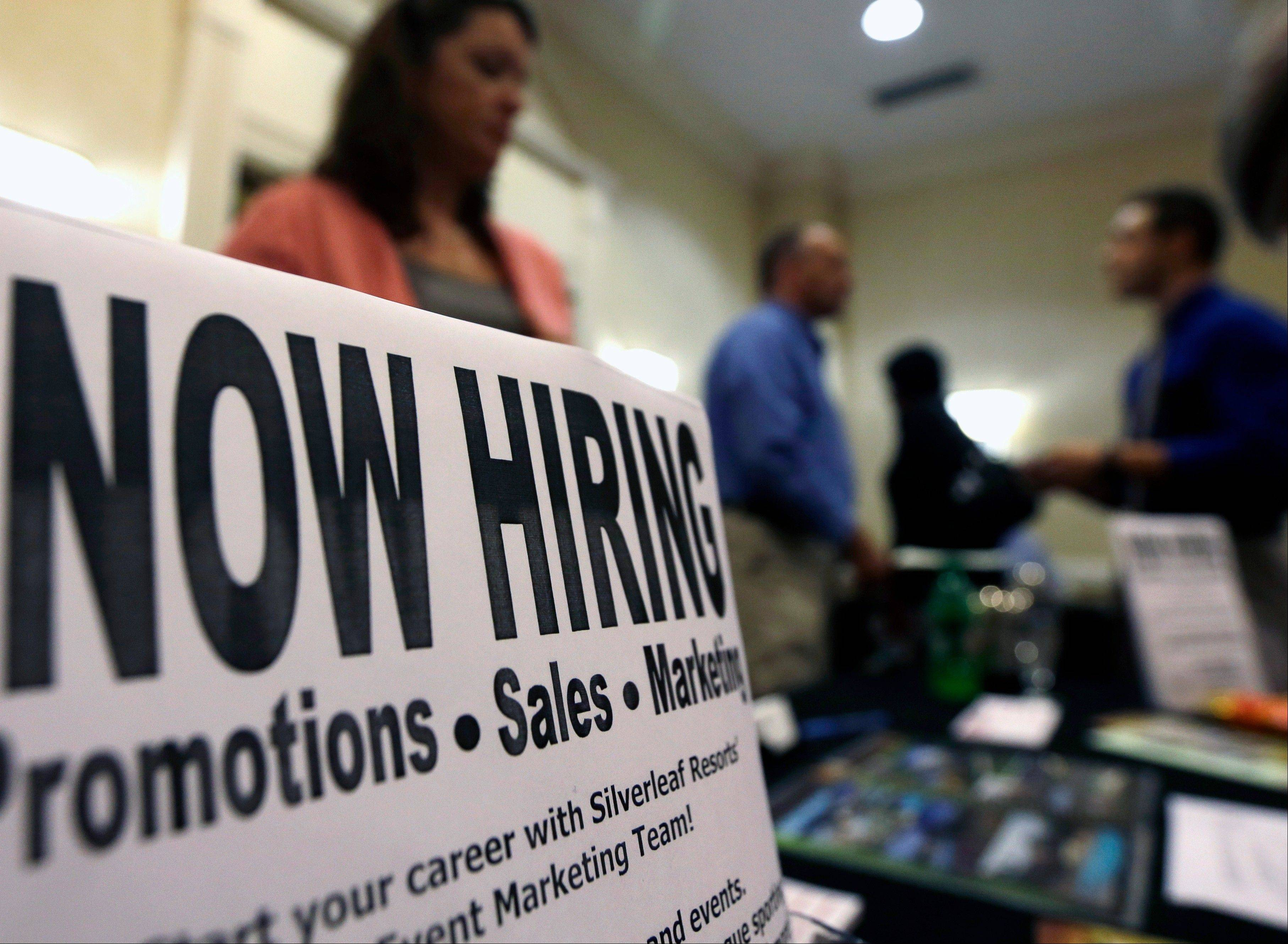 A sign attracts jobseekers during a job fair at the Marriott Hotel in Colonie, N.Y.