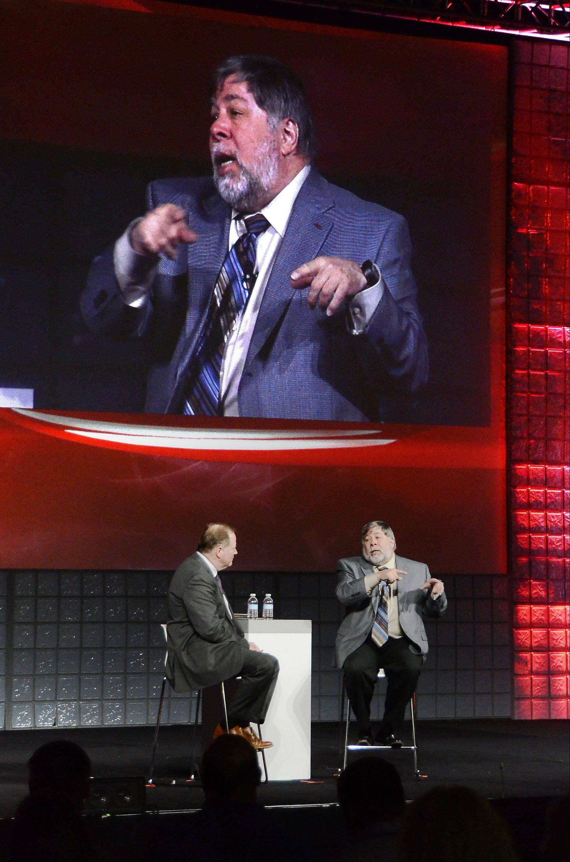 Steve Wozniak, right, inventor of the Apple I and Apple II computer and co-founder of Apple Computer with the late Steve Jobs, talks with Brett Schockley, Avaya senior vice president and general manager of applications and emerging technologies, at the Avaya Evolutions conference Thursday at the Schaumburg Convention Center.