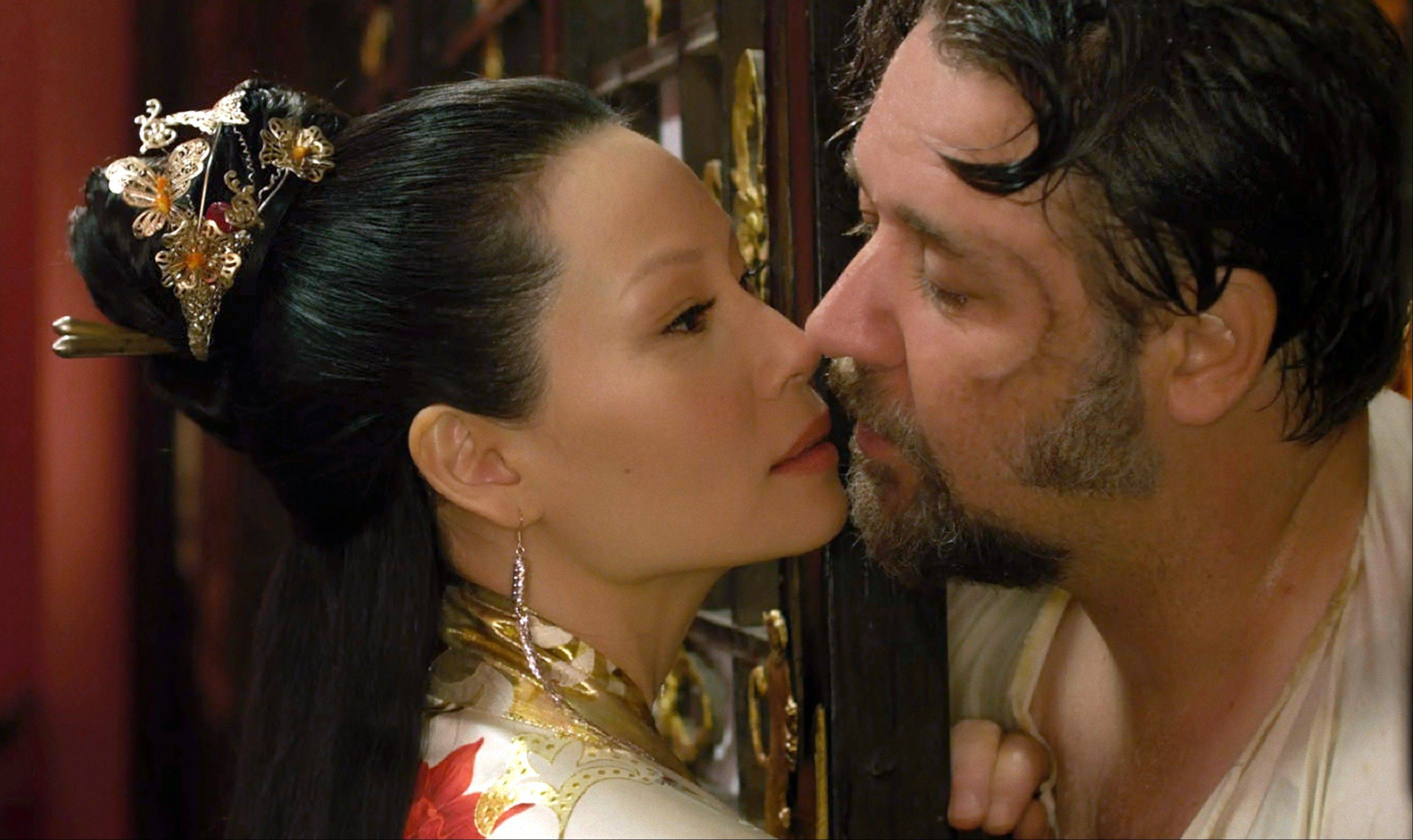"Jack Knife (Russell Crowe) gets close with an all-knowing madame (Lucy Liu) in ""The Man With the Iron Fists."""