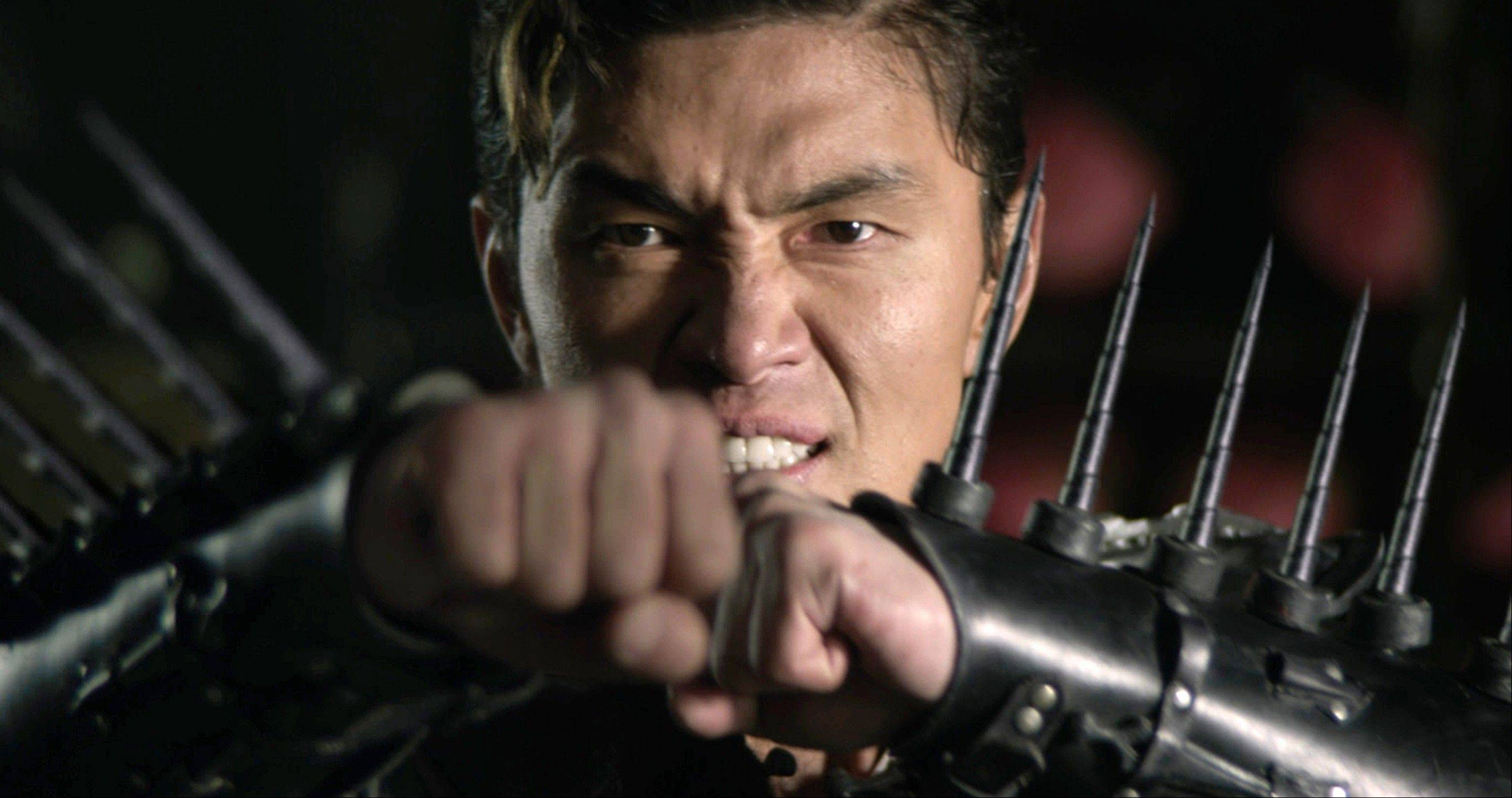 "The X-Blade (Rick Yune) prepares for battle in ""The Man With the Iron Fists."""