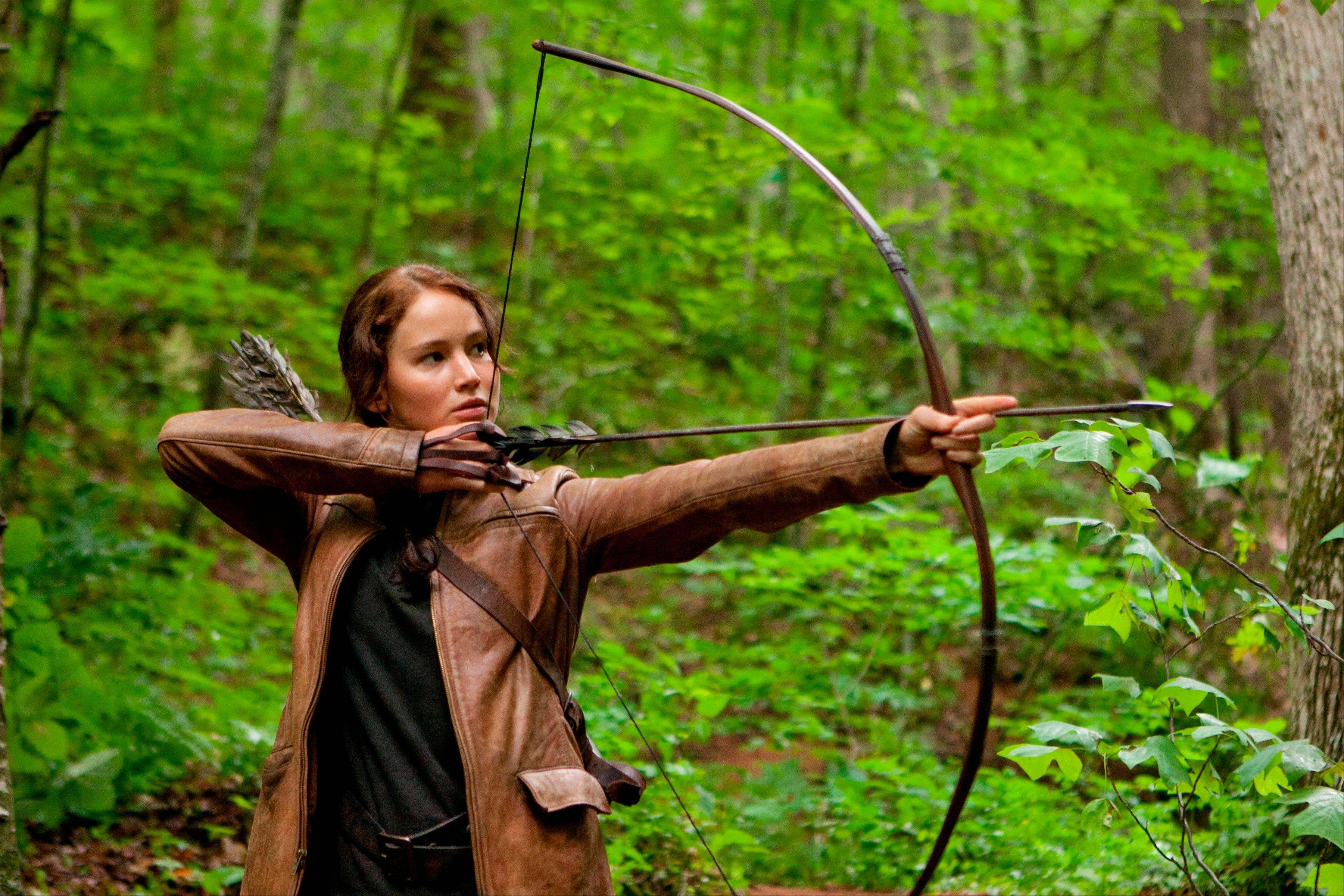 "Jennifer Lawrence plays Katniss Everdeen in ""The Hunger Games."" Lionsgate announced Thursday that ""The Hunger Games: Catching Fire"" filmmaker Francis Lawrence would also direct ""The Hunger Games: Mockingjay Part One"" and ""Part Two."""