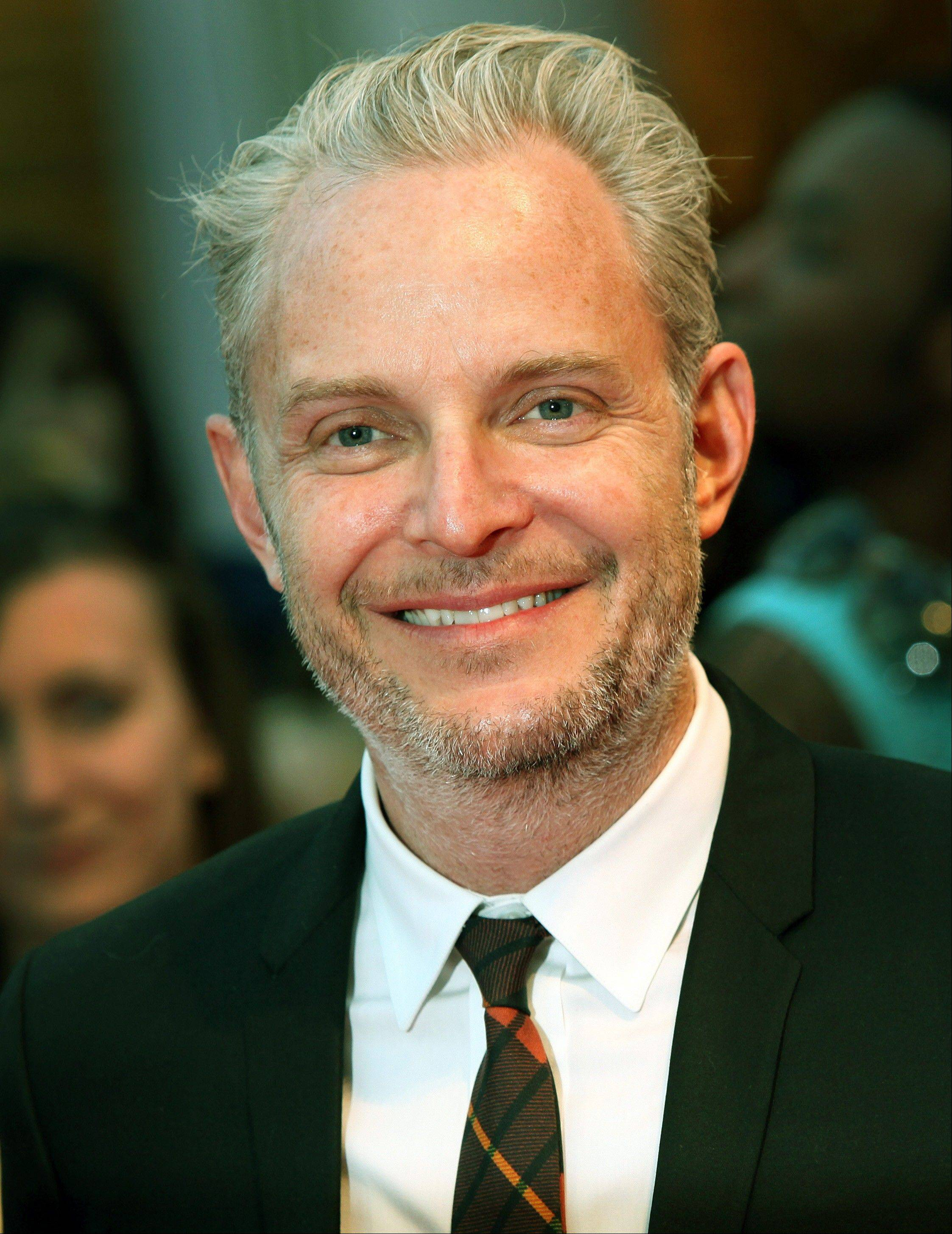 "Lionsgate announced Thursday that ""The Hunger Games: Catching Fire"" filmmaker Francis Lawrence would also direct ""The Hunger Games: Mockingjay Part One"" and ""Part Two."""