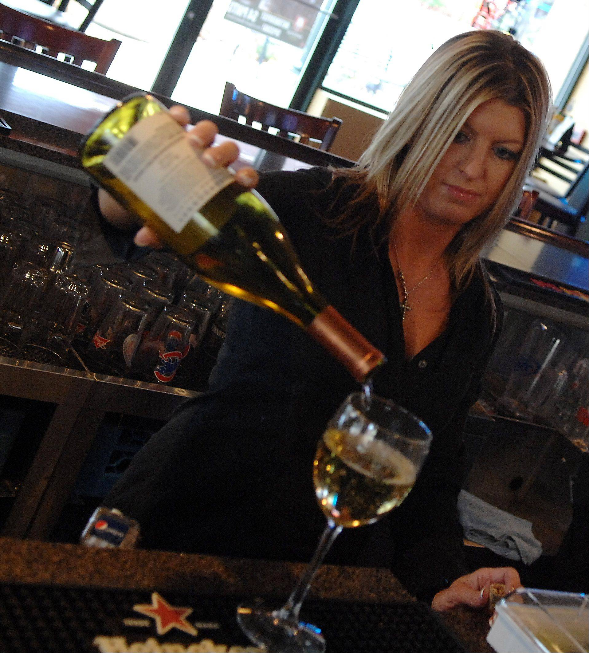 Bartender Christy Arnold pours a glass of wine at ThreeB in Geneva.