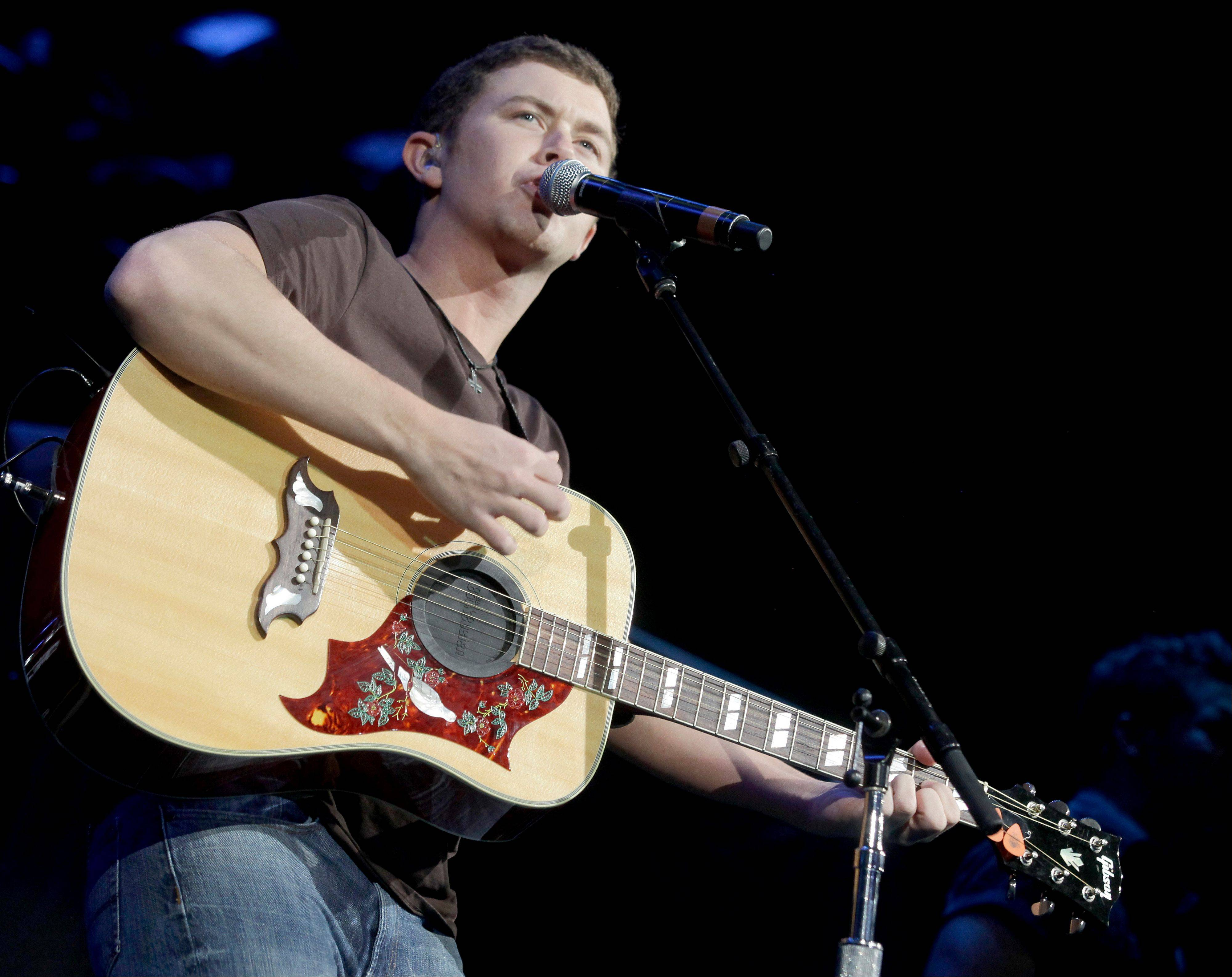 Scotty McCreery juggles his performing career with college these days.