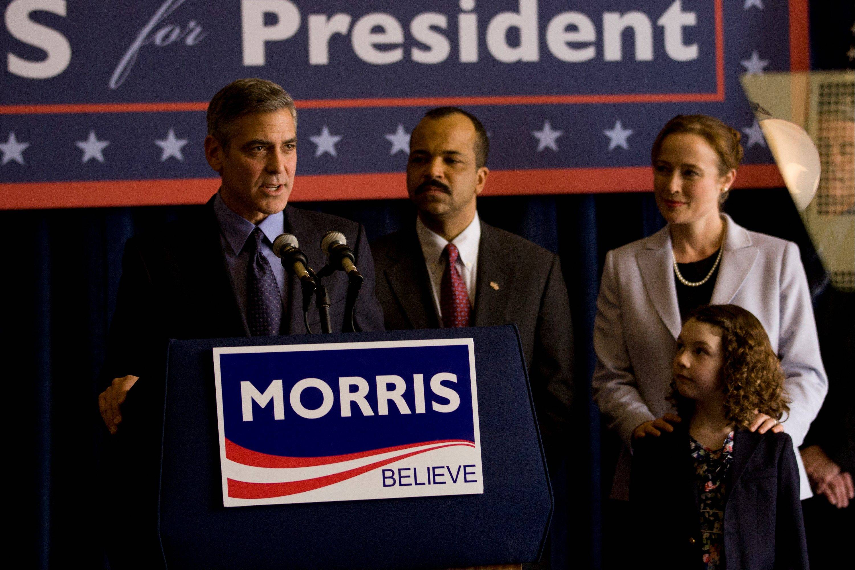"A Democratic presidential candidate (director George Clooney), left, finagles an endorsement from an influential senator (Jeffrey Wright) in ""Ides of March."""