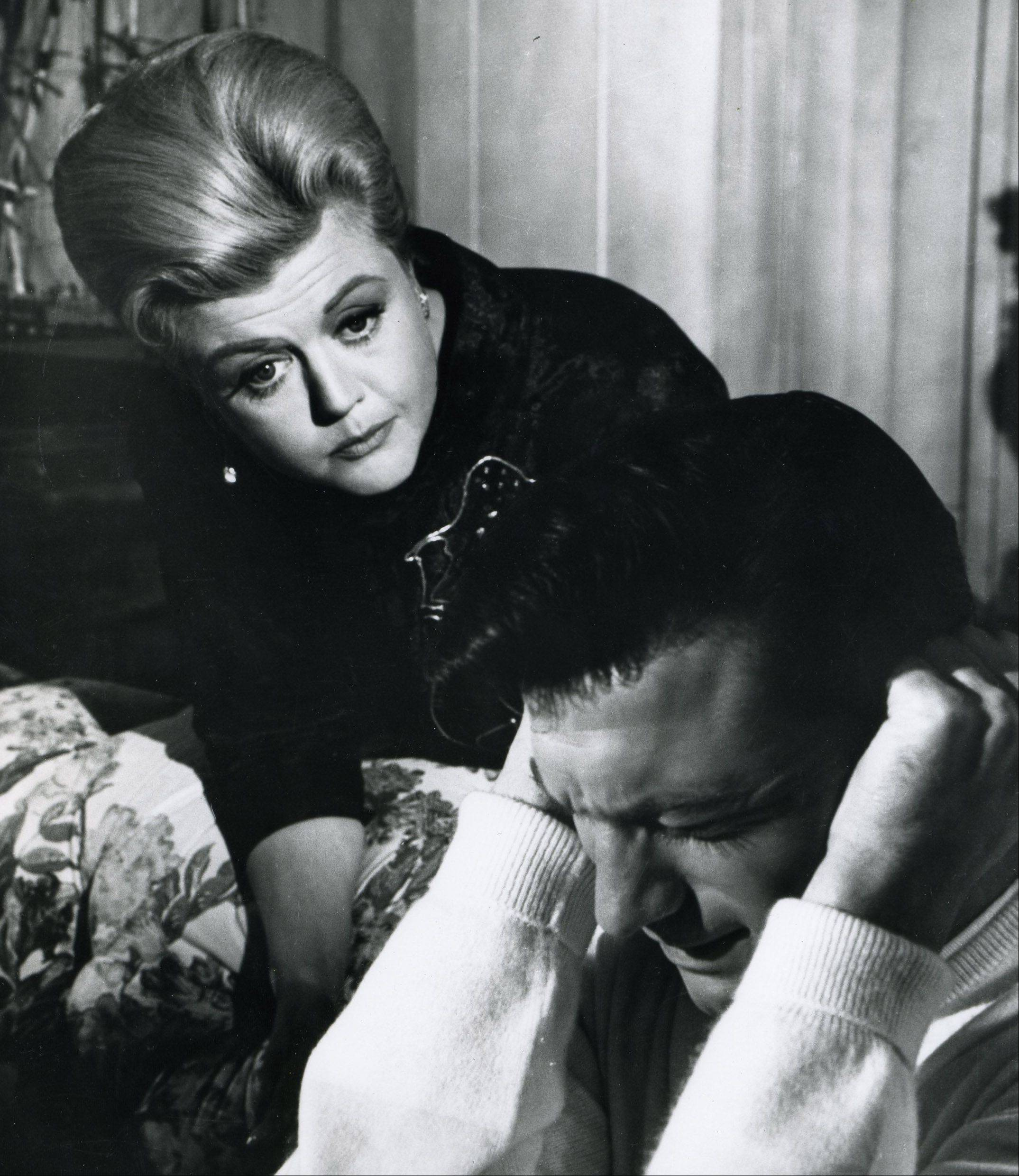 "The conniving mother (Angela Lansbury) of a Korean War veteran (Laurence Harvey) seeks to influence American politics in ""The Manchurian Candidate."""