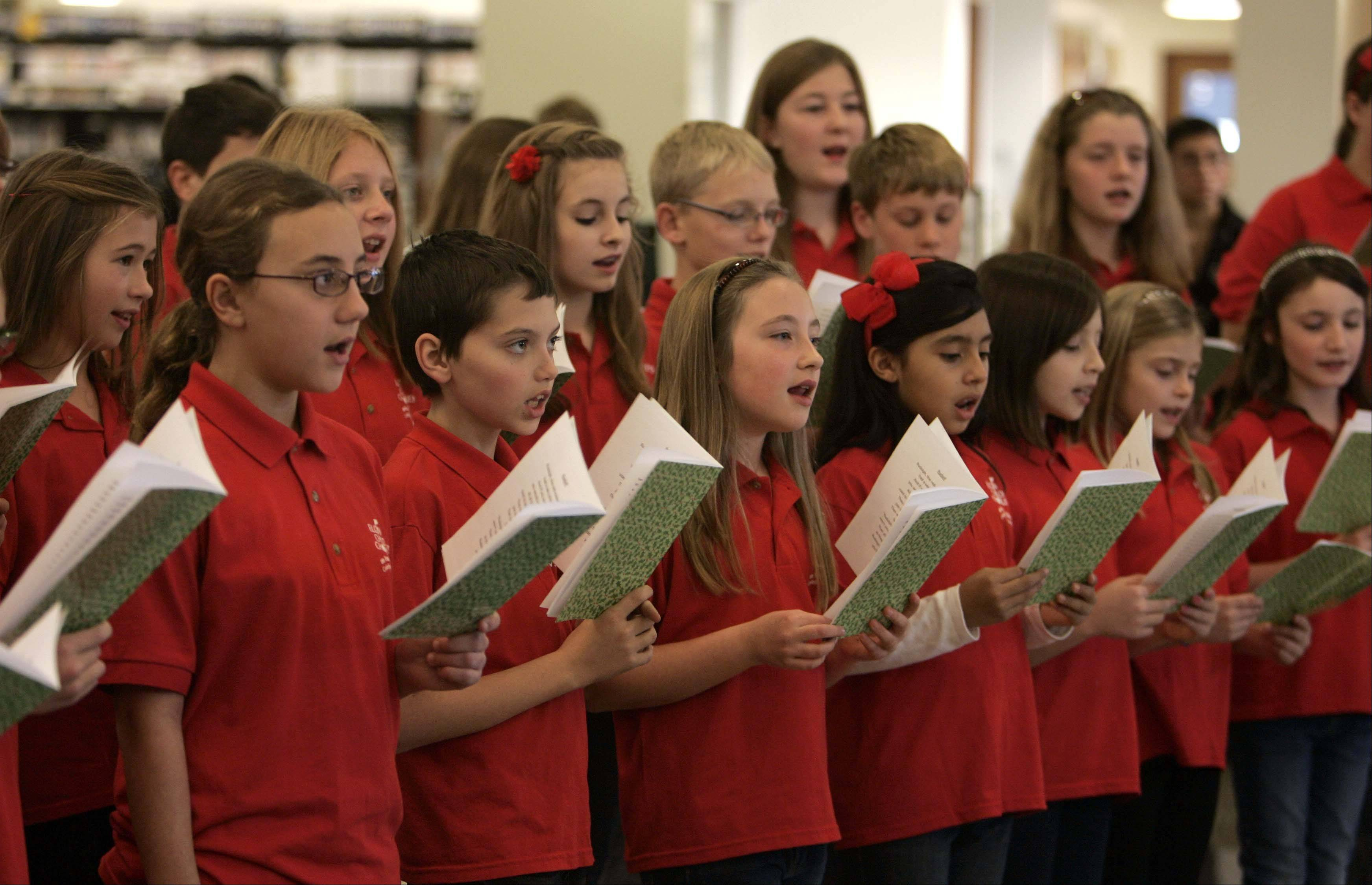 Brian Hill/bhill@dailyherald.comThe Elgin Children's Chorus performs during the Elgin Home for the Holidays, event Saturday at the Gail Borden Public Library in Elgin.