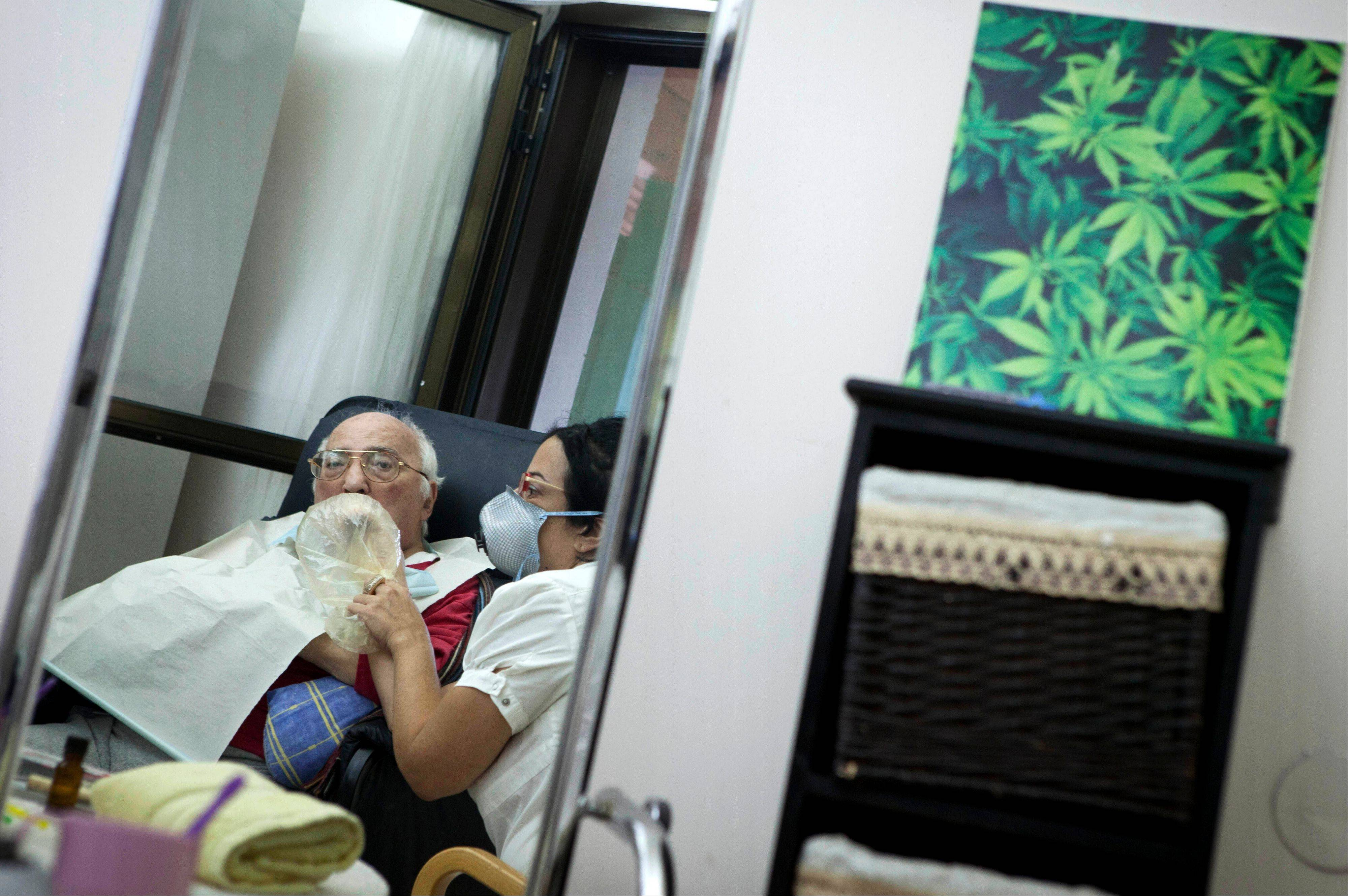 Rom Germad inhales medical cannabis at the old age nursery home in kibbutz Naan next to the city of Rehovot, Israel.