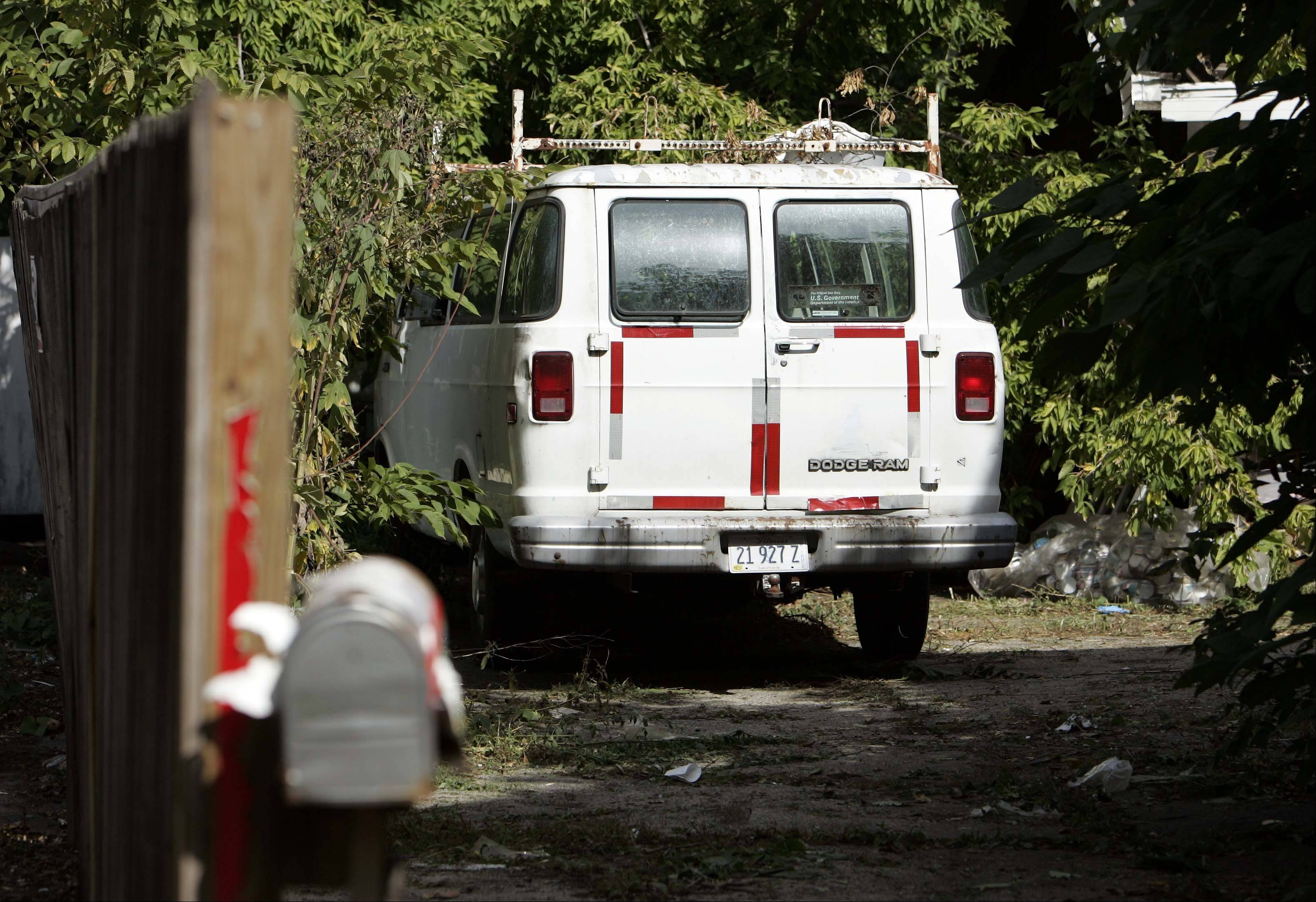 Elgin police say they found 43 dead and decaying animals in this van parked outside a home in the 200 block of Villa Street. William Tinkler, 60, who lives there, later arrested on related animal cruelty charges.