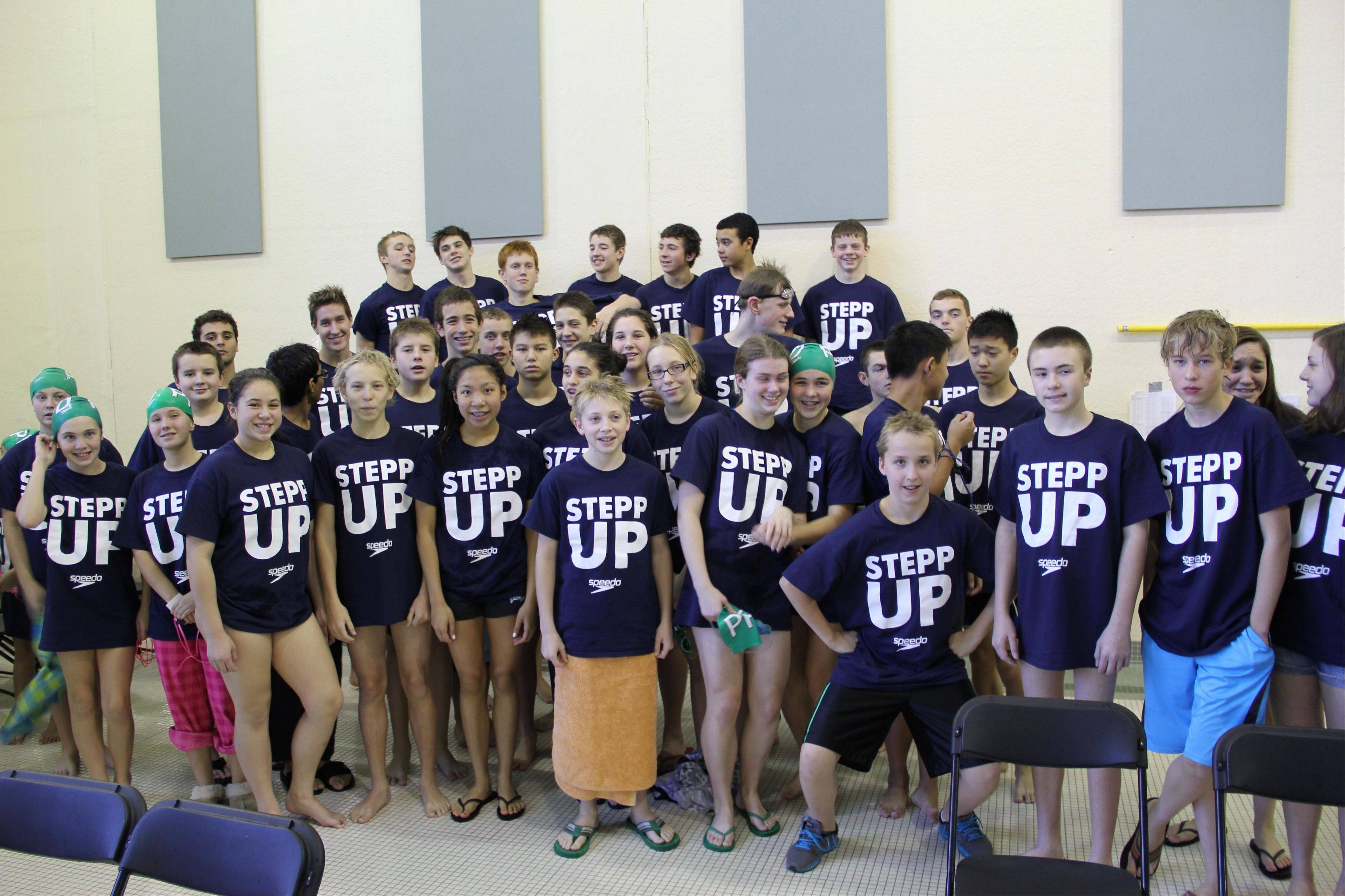 "Members of the Palatine Park District Tiger Sharks swim team wear ""Stepp Up"" T-shirts in memory of former teammate, Ben Stepp."