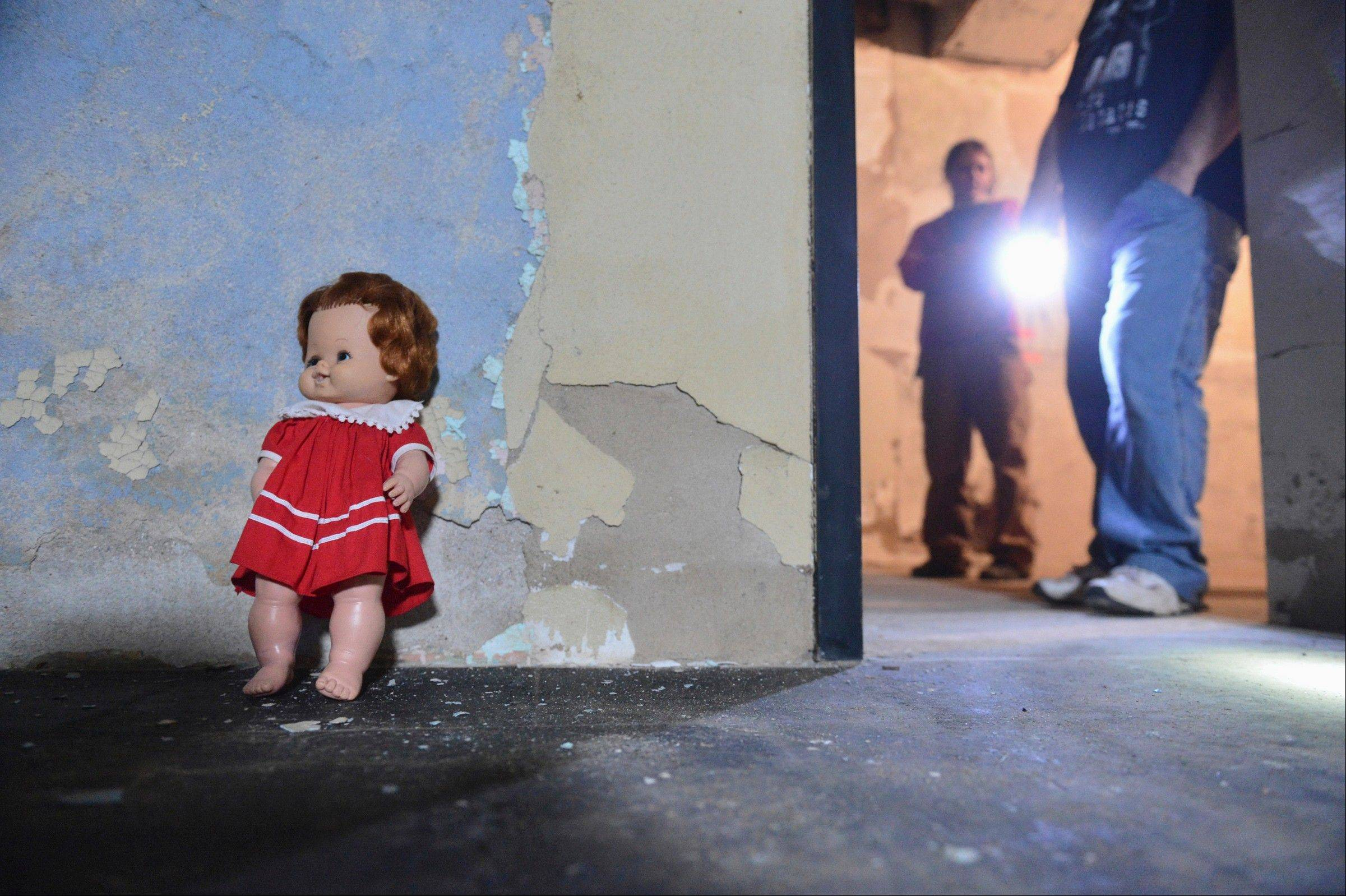 Richard and Trish Weiss, stand outside a room where they placed a small doll, a request they heard from an electronic voice phenomenon event, where they are continuing their work to rehab the former Illinois Asylum for The Incurable Insane, a mental hospital located in Bartonville Richard said that sometimes they come in and the dolls arms are raised.