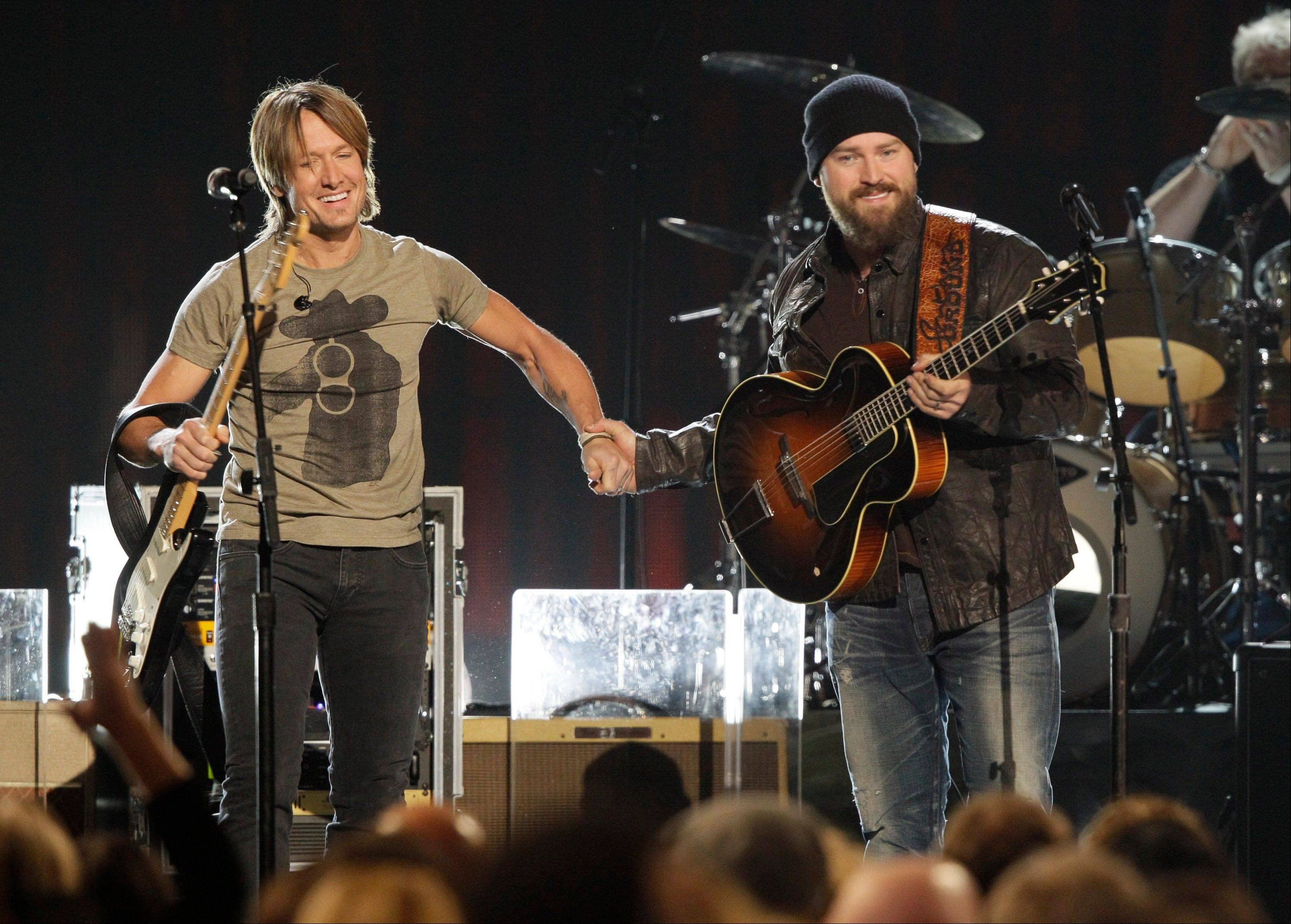 Keith Urban, left, and Zac Brown perform at the 46th Annual Country Music Awards at the Bridgestone Arena on Thursday, Nov. 1, 2012, in Nashville, Tenn.