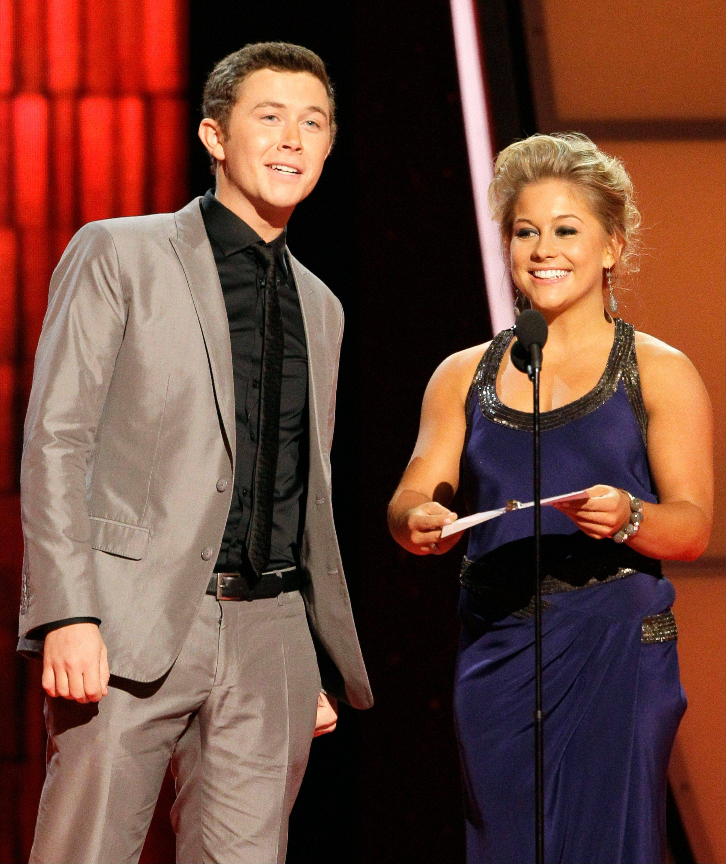 Scotty McCreery, left, and Shawn Johnson present the award for vocal group of the year at the 46th Annual Country Music Awards at the Bridgestone Arena on Thursday, Nov. 1, 2012, in Nashville, Tenn.