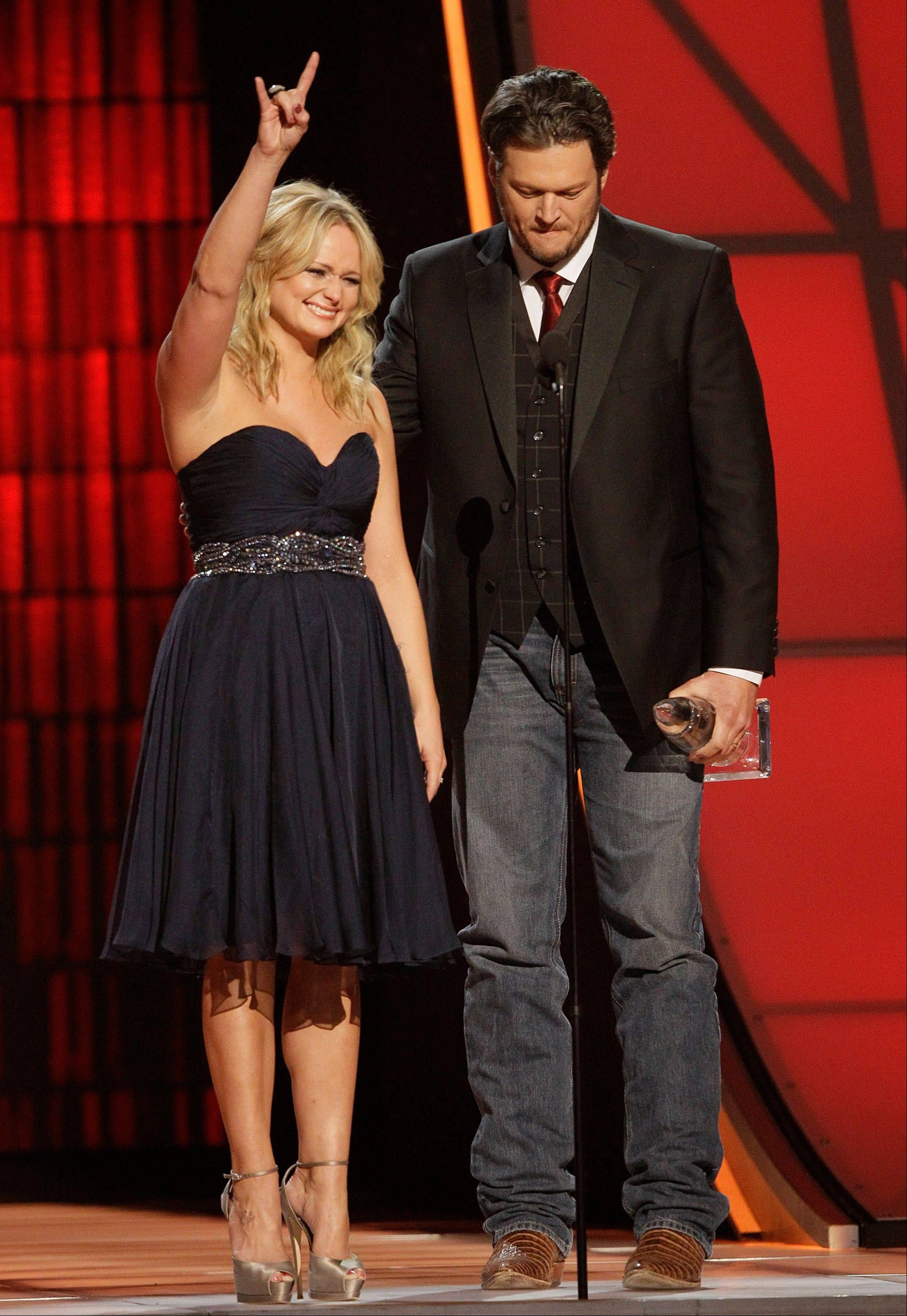 "Miranda Lambert, left, and Blake Shelton accept song of the year award for ""Over You"" at the 46th Annual Country Music Awards at the Bridgestone Arena on Thursday, Nov. 1, 2012, in Nashville, Tenn."