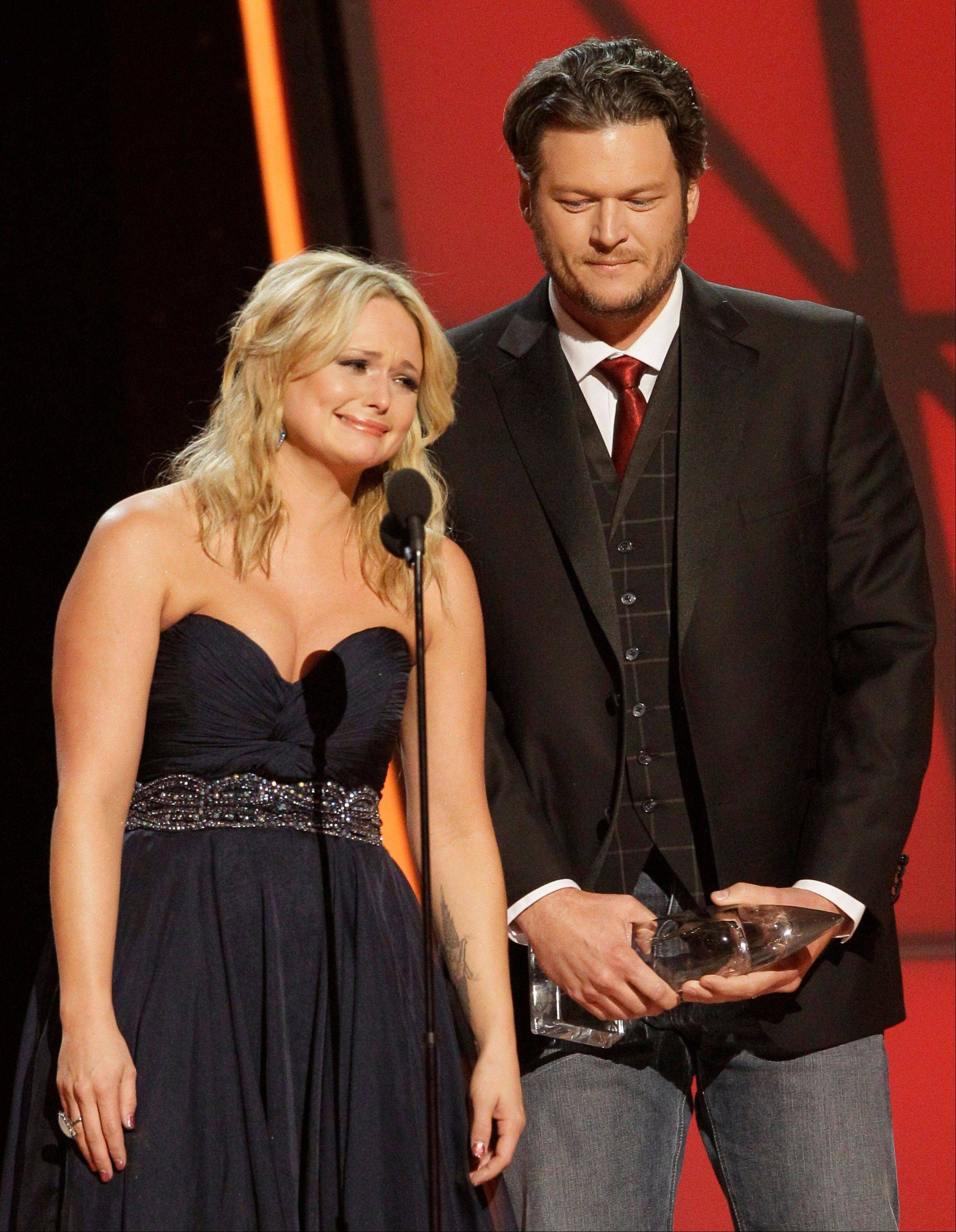 "Miranda Lambert, left, and Blake Shelton accept song of the year award for ""Over You"" at the 46th Annual Country Music Awards at the Bridgestone Arena on Thursday, Nov. 1, 2012, in Nashville, Tenn. Lambert got emotional as Shelton talked about the loss of his brother Richie and the song he wrote to honor him."