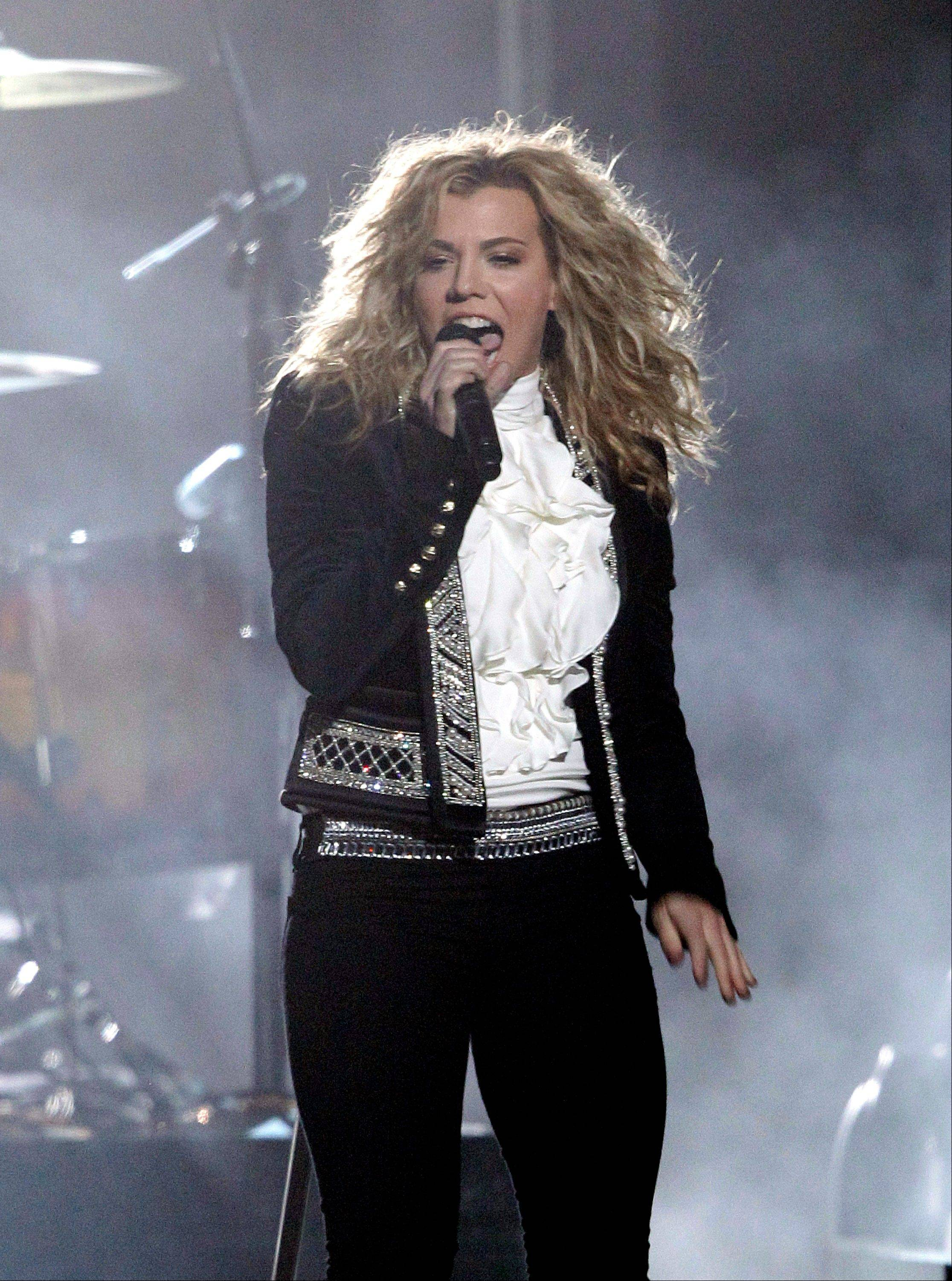 Kimberly Perry, of musical group The Band Perry, performs onstage at the 46th Annual Country Music Awards at the Bridgestone Arena on Thursday, Nov. 1, 2012, in Nashville, Tenn.