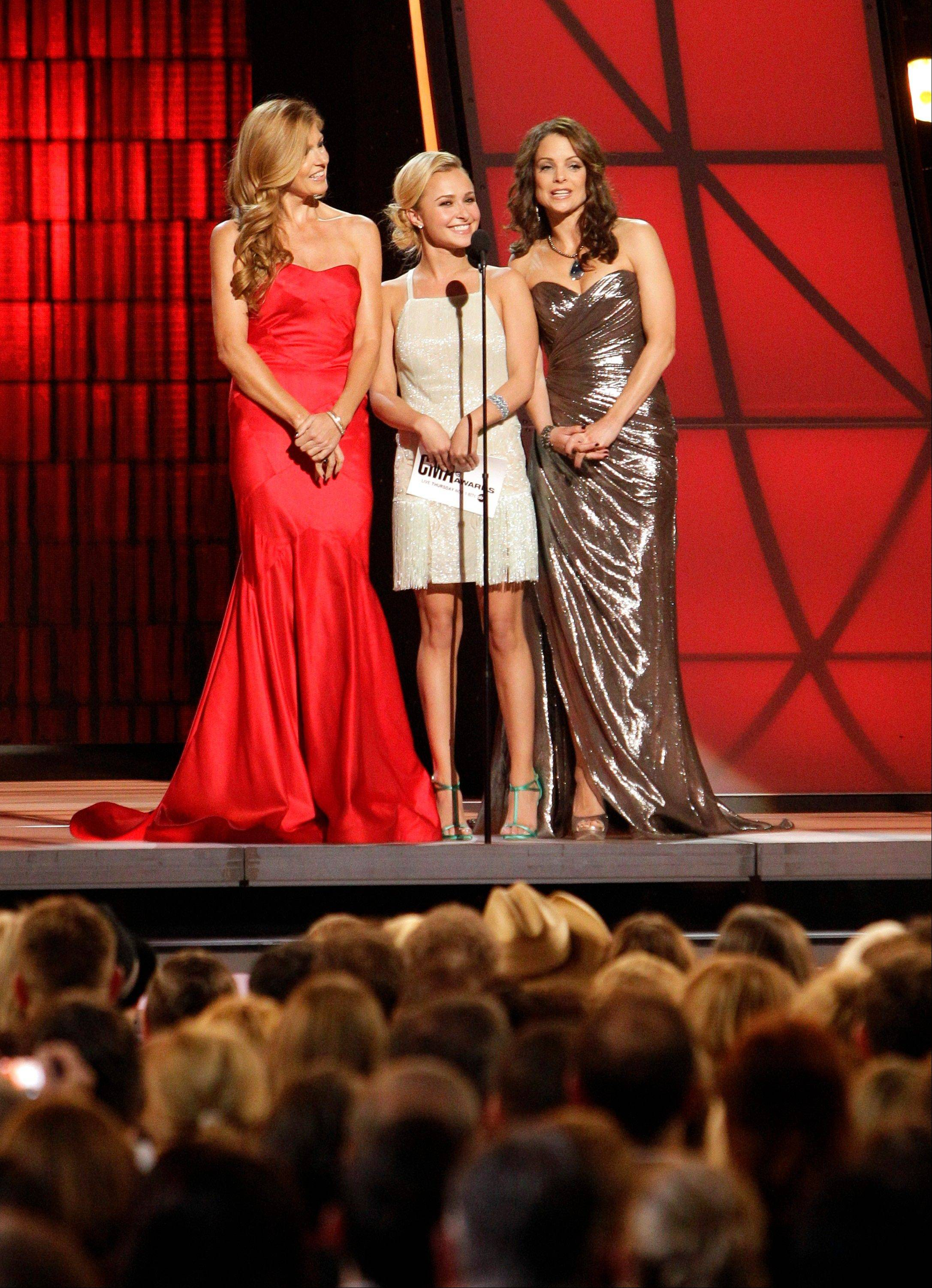 Connie Britton, from left, Hayden Panettiere and Kimberly Williams-Paisley present the award for female vocalist of the year at the 46th Annual Country Music Awards at the Bridgestone Arena on Thursday, Nov. 1, 2012, in Nashville, Tenn.
