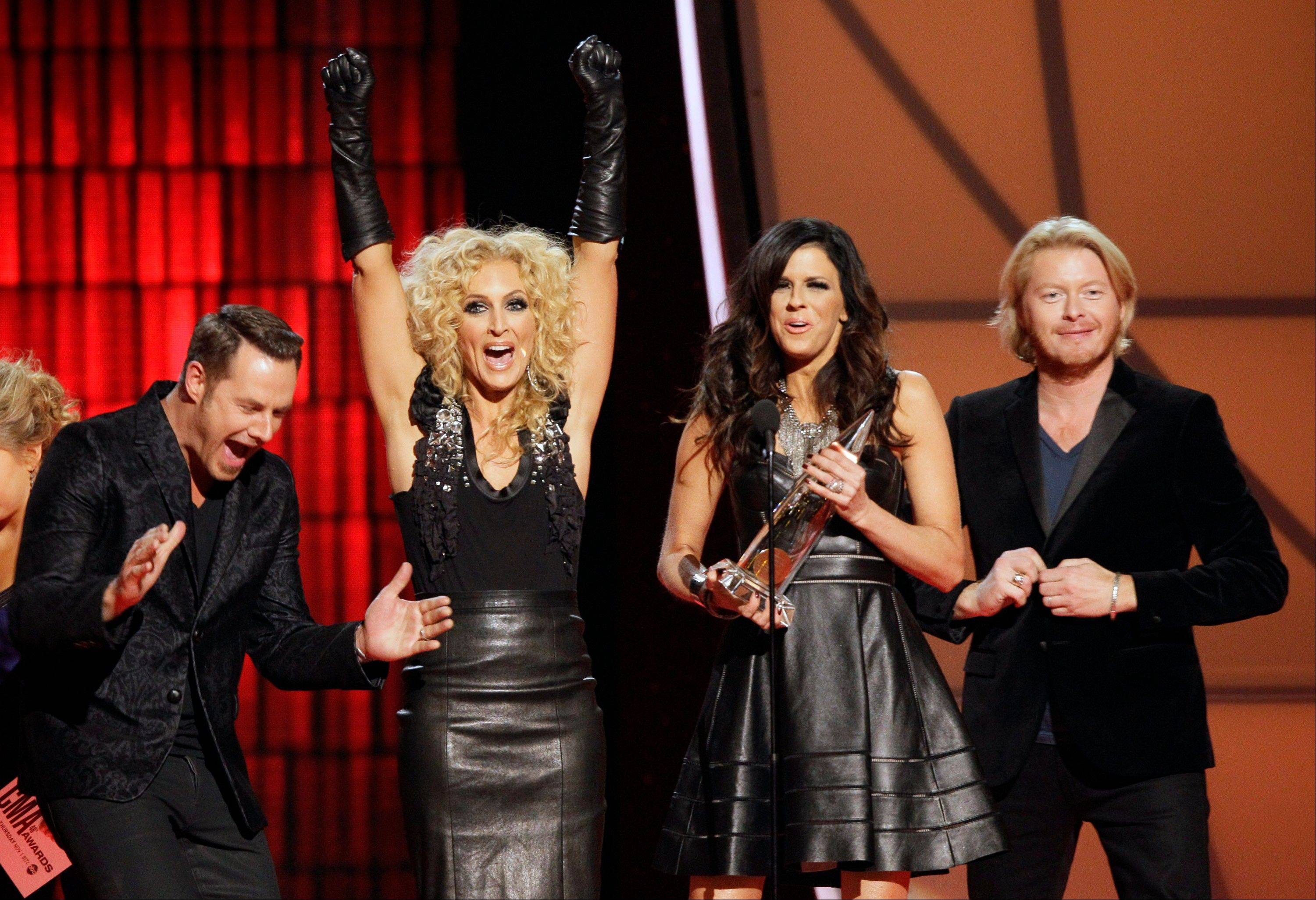 Jimi Westbrook, from left, Kimberly Schlapman, Karen Fairchild and Phillip Sweet, of Little Big Town, accept the award for vocal group of the year at the 46th Annual Country Music Awards at the Bridgestone Arena on Thursday, Nov. 1, 2012, in Nashville, Tenn.