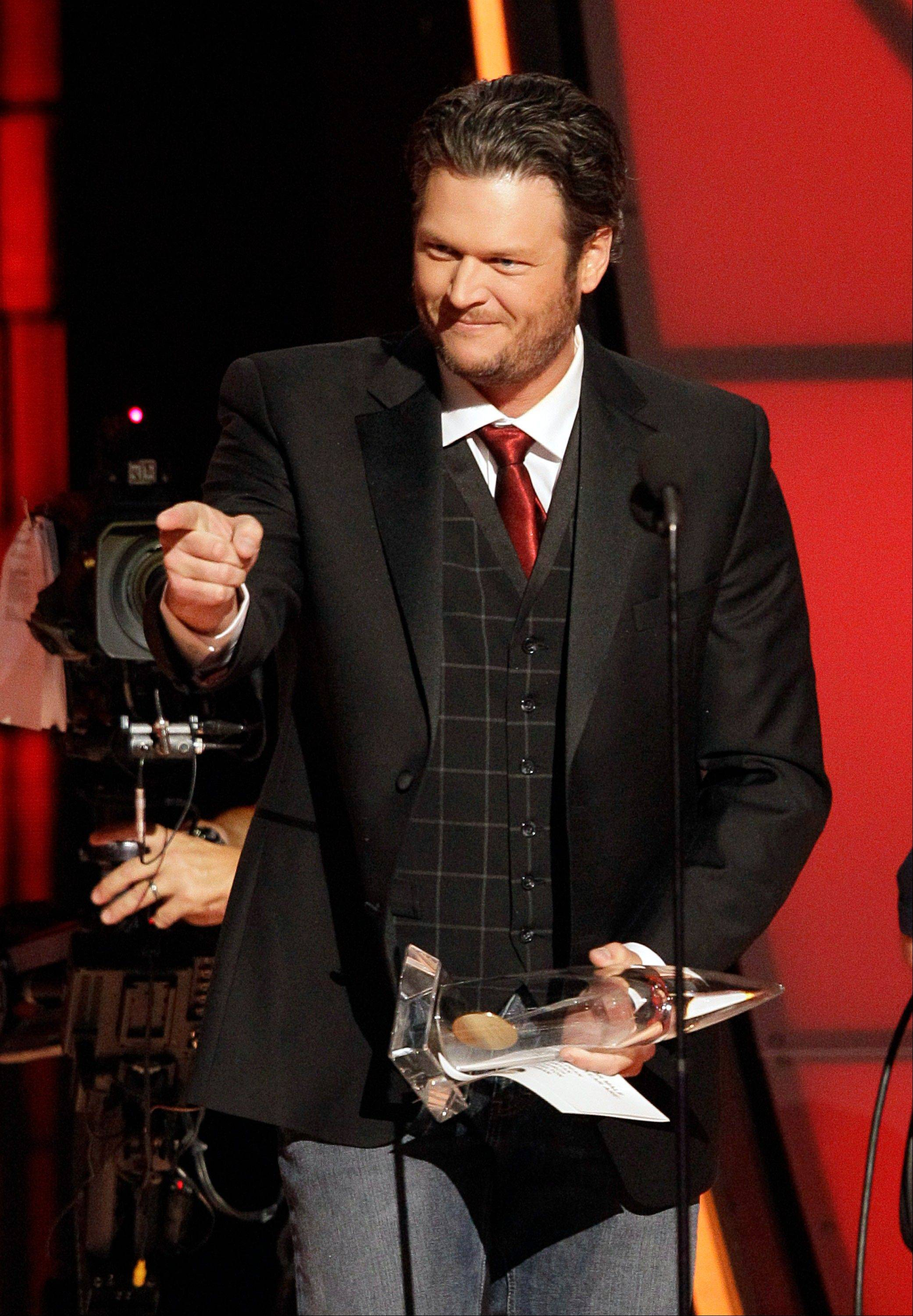 Blake Shelton accepts the award for male vocalist of the year at the 46th Annual Country Music Awards at the Bridgestone Arena on Thursday, Nov. 1, 2012, in Nashville, Tenn.