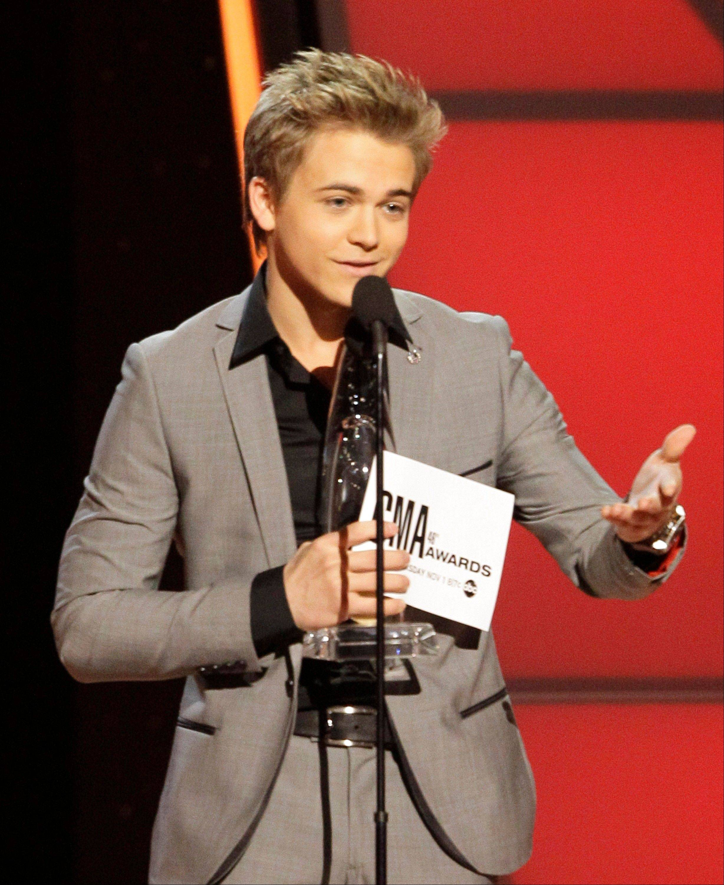 Hunter Hayes accepts the new artist of the year award at the 46th Annual Country Music Awards at the Bridgestone Arena on Thursday, Nov. 1, 2012, in Nashville, Tenn.