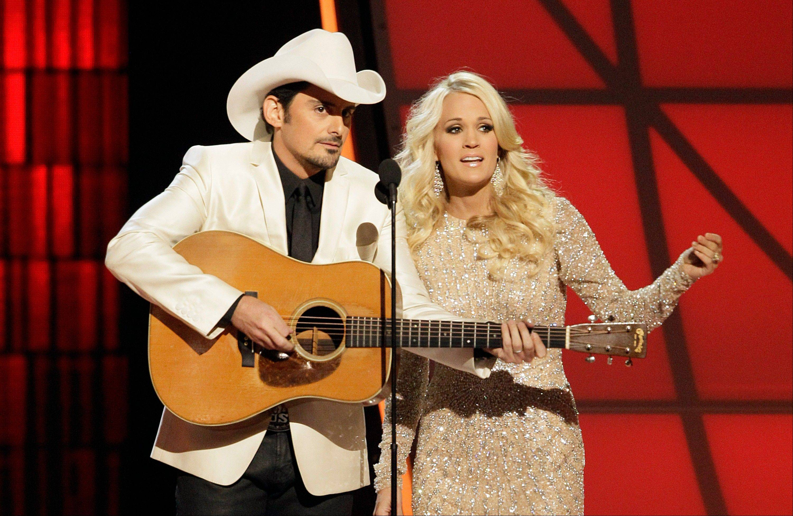 Hosts Brad Paisley, left, and Carrie Underwood perform an opening number onstage at the 46th Annual Country Music Awards at the Bridgestone Arena on Thursday, Nov. 1, 2012, in Nashville, Tenn.