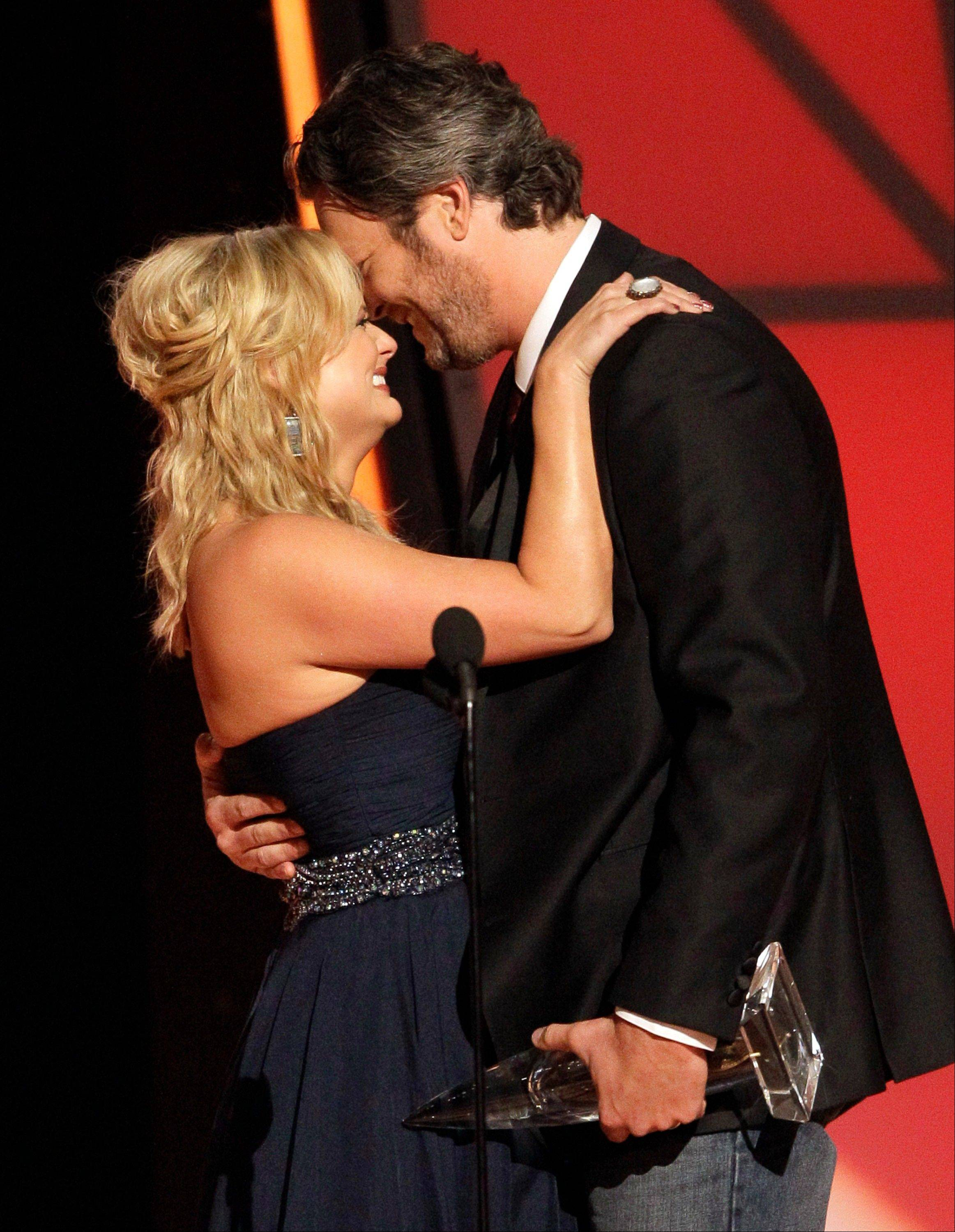 "Miranda Lambert, left, and Blake Shelton embrace onstage after winning the award for song of the year for ""Over You"" at the 46th Annual Country Music Awards at the Bridgestone Arena on Thursday, Nov. 1, 2012, in Nashville, Tenn."