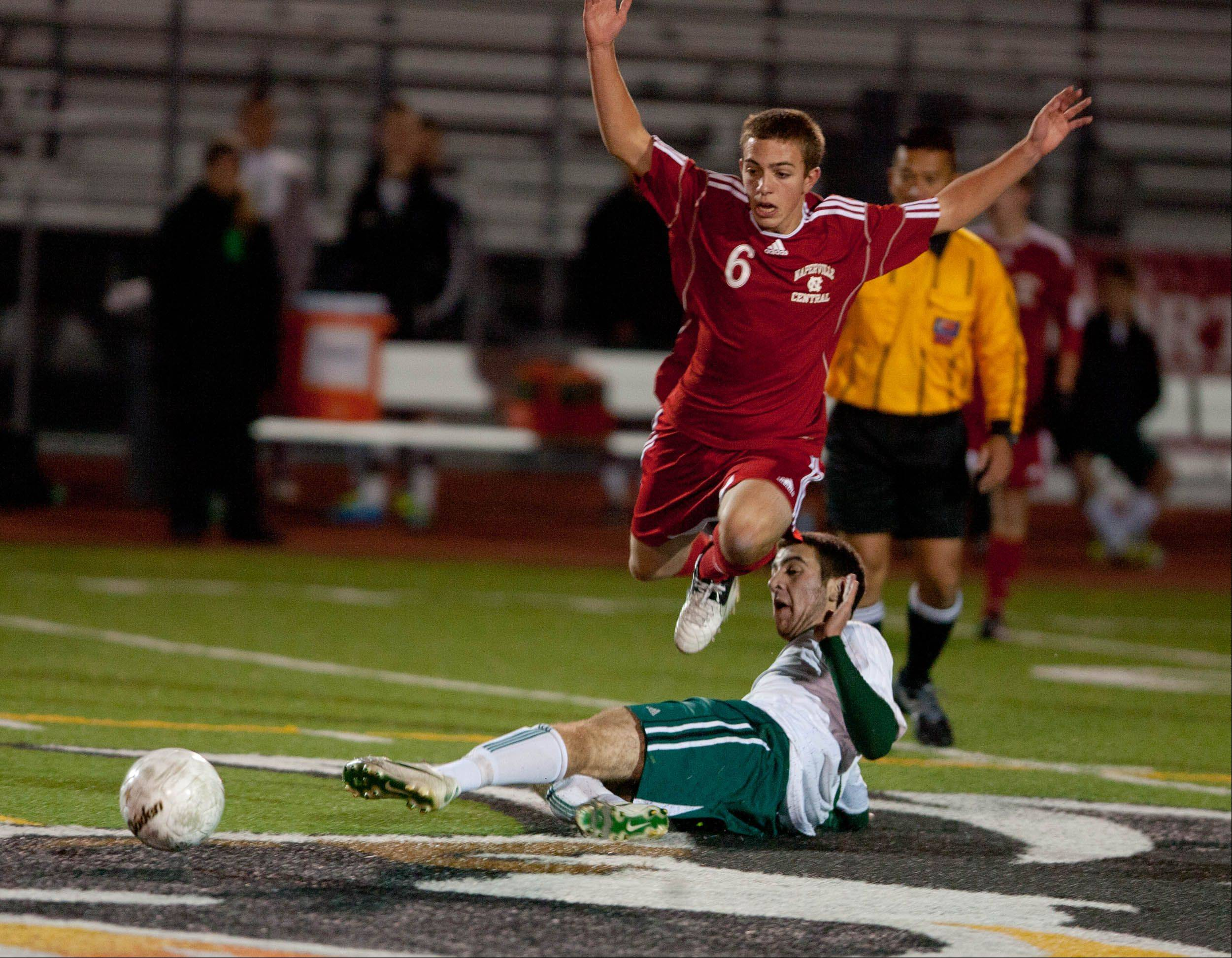 Naperville Central's Mike West, (6), battles Stevenson's, Alex Drexler, during the boys 3A state semifinal soccer match held at Lincoln-Way North High School.