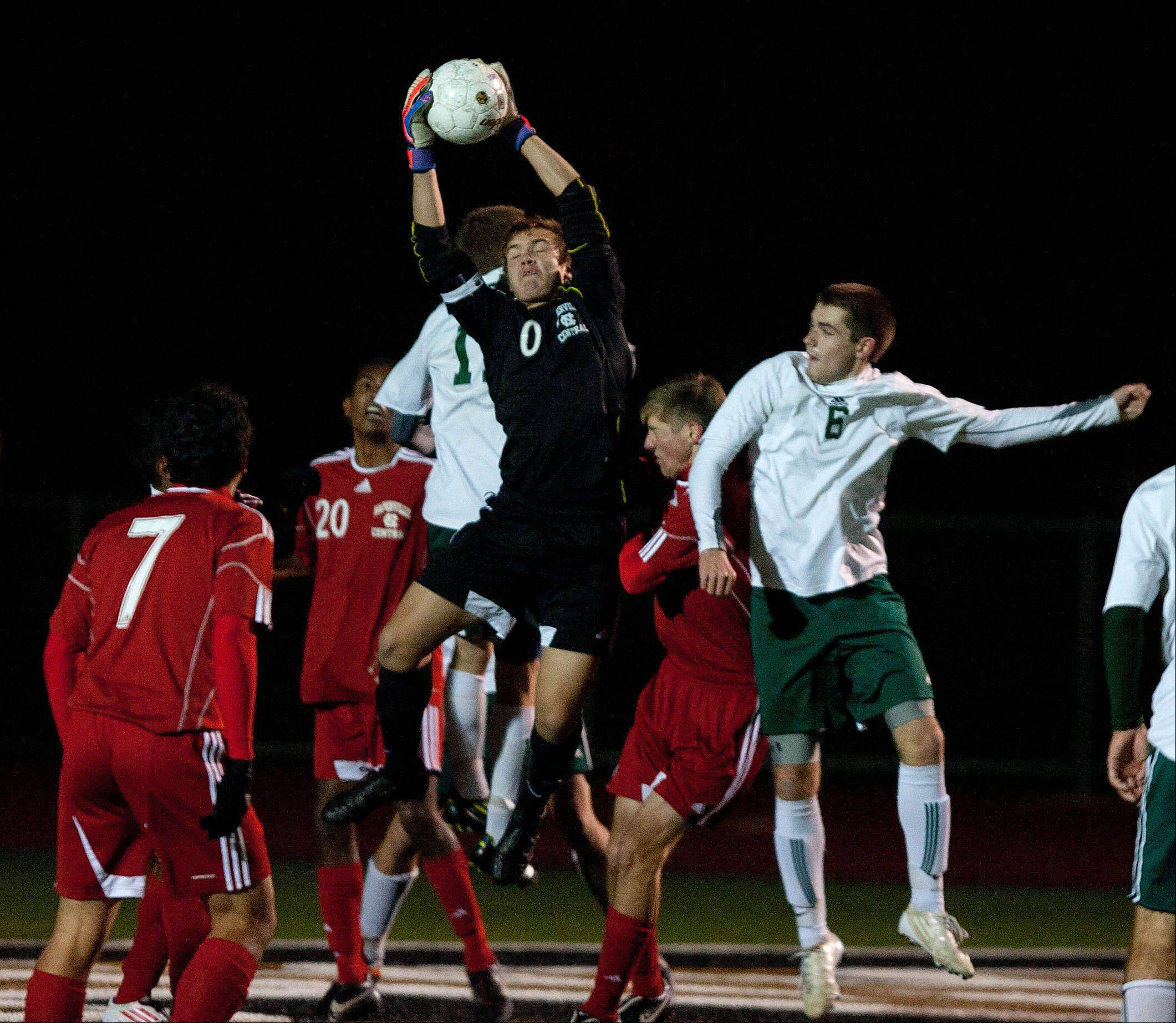 Daniel White/dwhite@dailyherald.comNaperville Central goalkeeper Jon Bedell makes the save over Stevenson's Alex Smith (6), during the boys 3A state semifinal soccer match held at Lincoln-Way North High School.