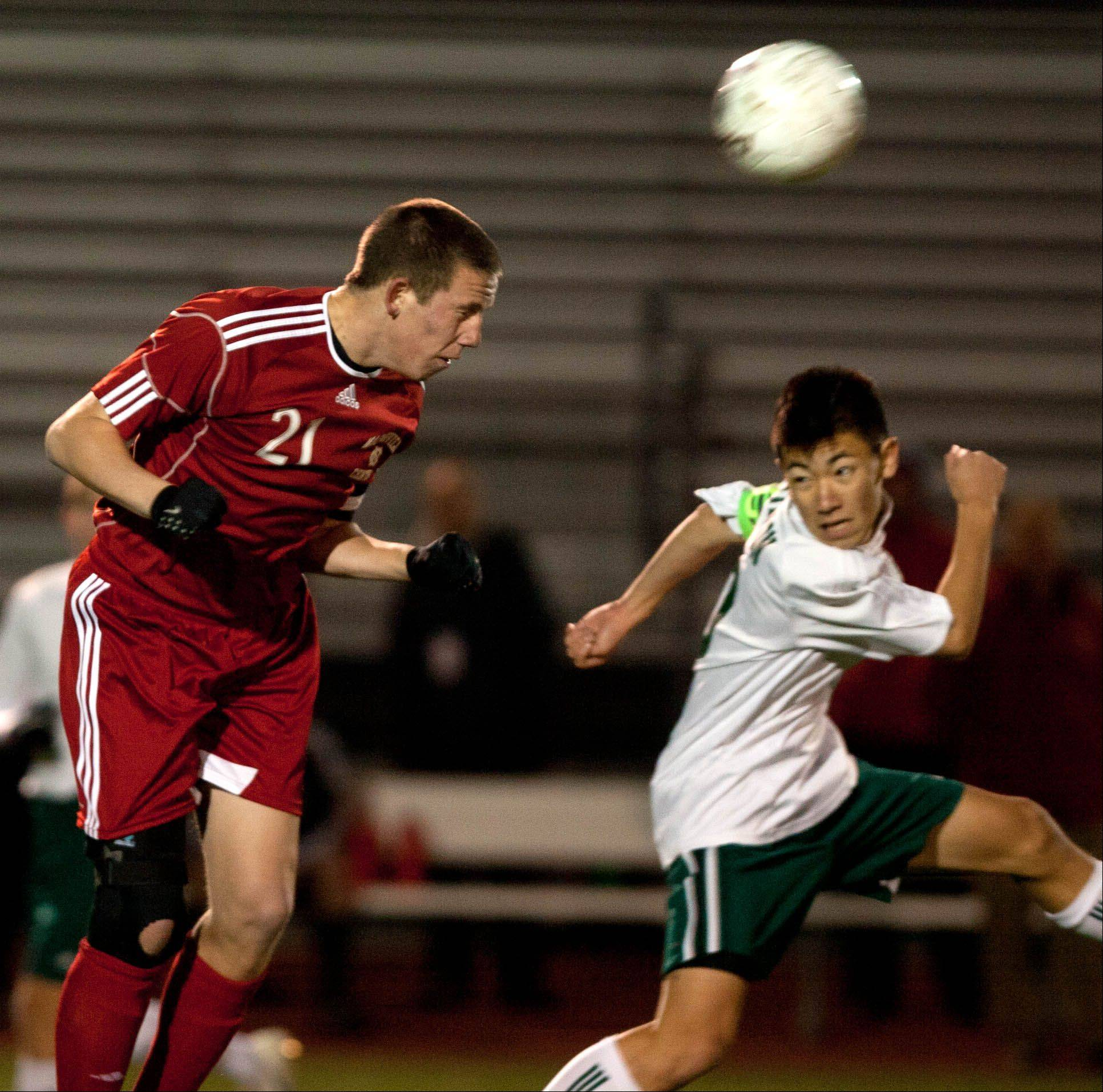 Naperville Central's Jack Patrick, left, battles Stevenson's Toshiki Niimi, right, during the boys 3A state semifinal soccer match held at Lincoln-Way North High School.