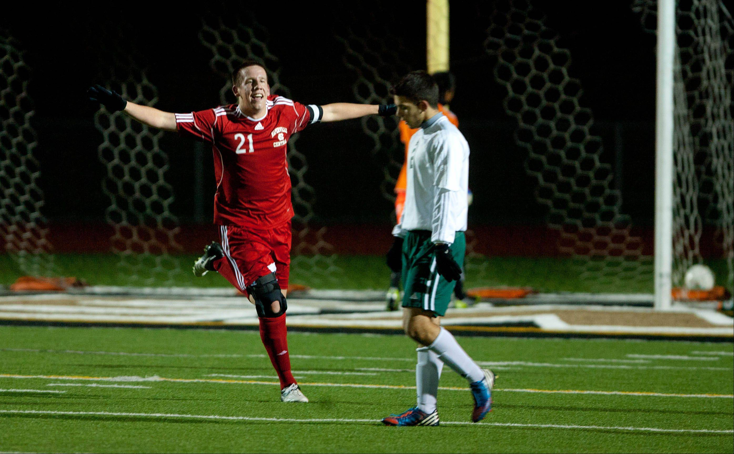 Naperville Central's Jack Patrick (21), celebrates his goal giving the Redhawks a 2-0 lead over Stevenson, during the boys 3A state semifinal soccer match held at Lincoln-Way North High School.
