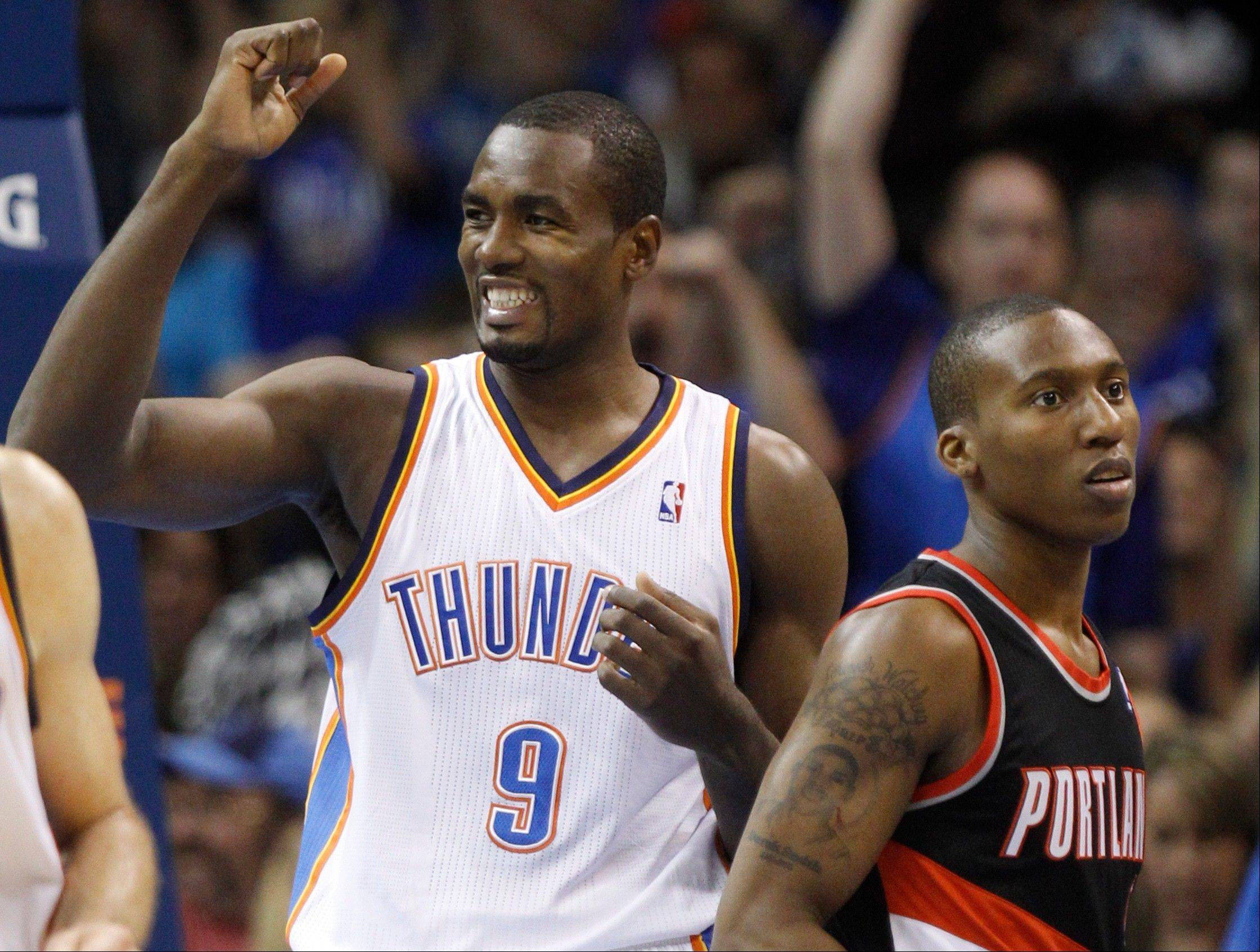 Oklahoma City Thunder forward Serge Ibaka celebrates Friday after a basket by a teammate in the second quarter against the Portland Trail Blazers in Oklahoma City.