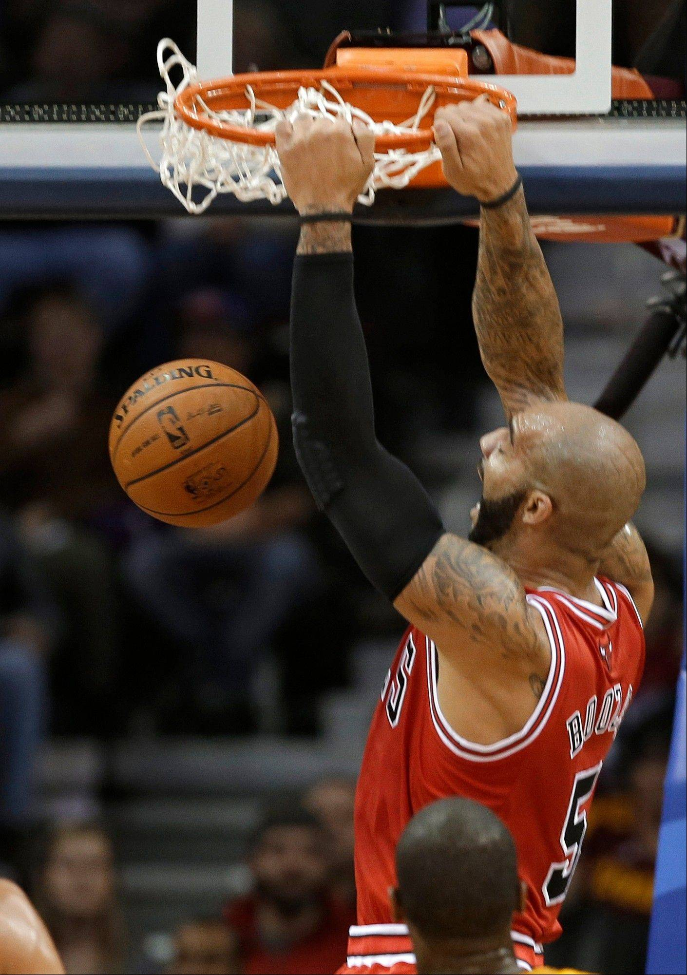 Chicago Bulls' Carlos Boozer dunks against the Cleveland Cavaliers in the first quarter of an NBA basketball game Friday, Nov. 2, 2012, in Cleveland.
