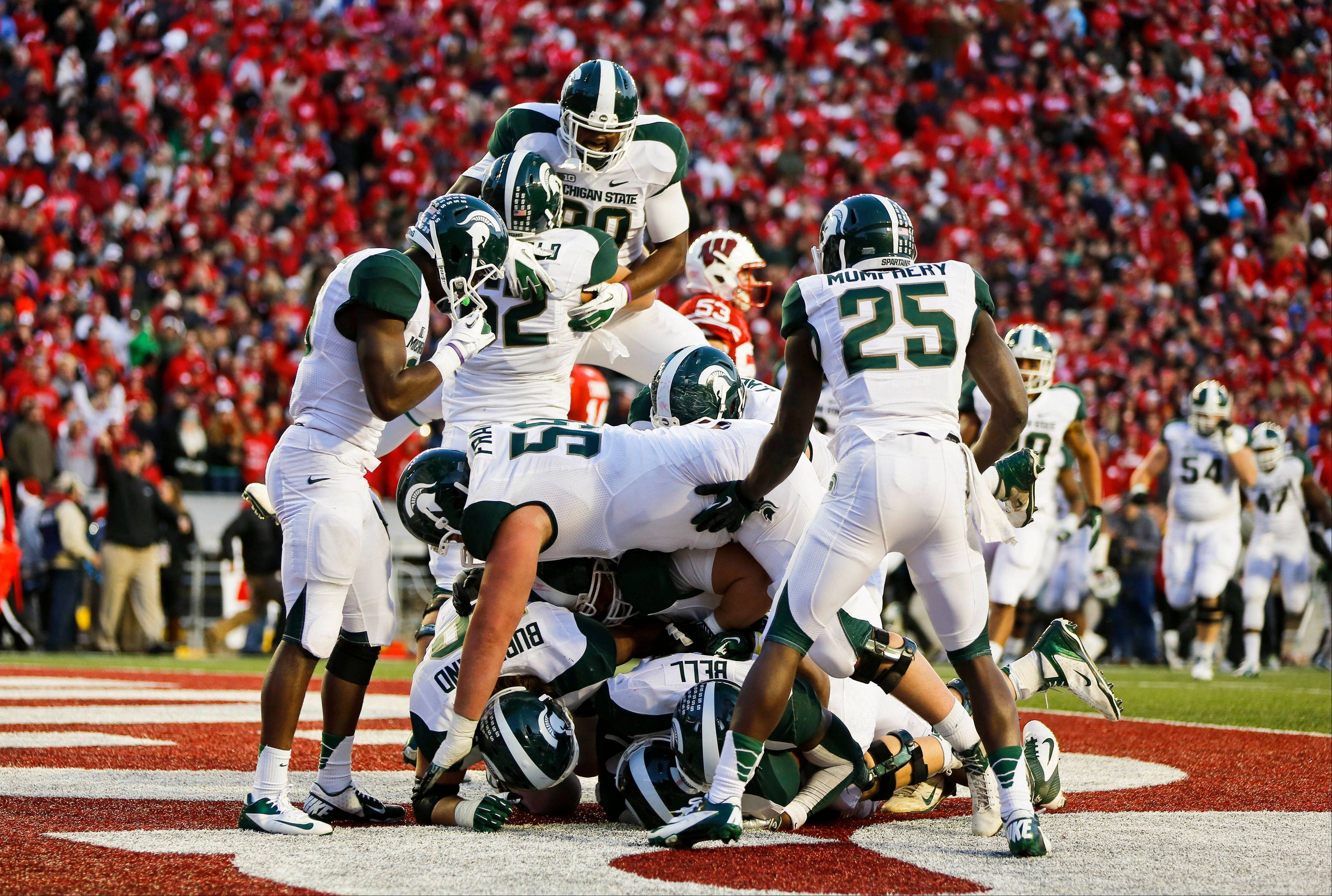 Michigan State players celebrate after defeating Wisconsin 16-13 Saturday. Michigan State can spoil Nebraska's Big Ten championship hopes with a victory Saturday.