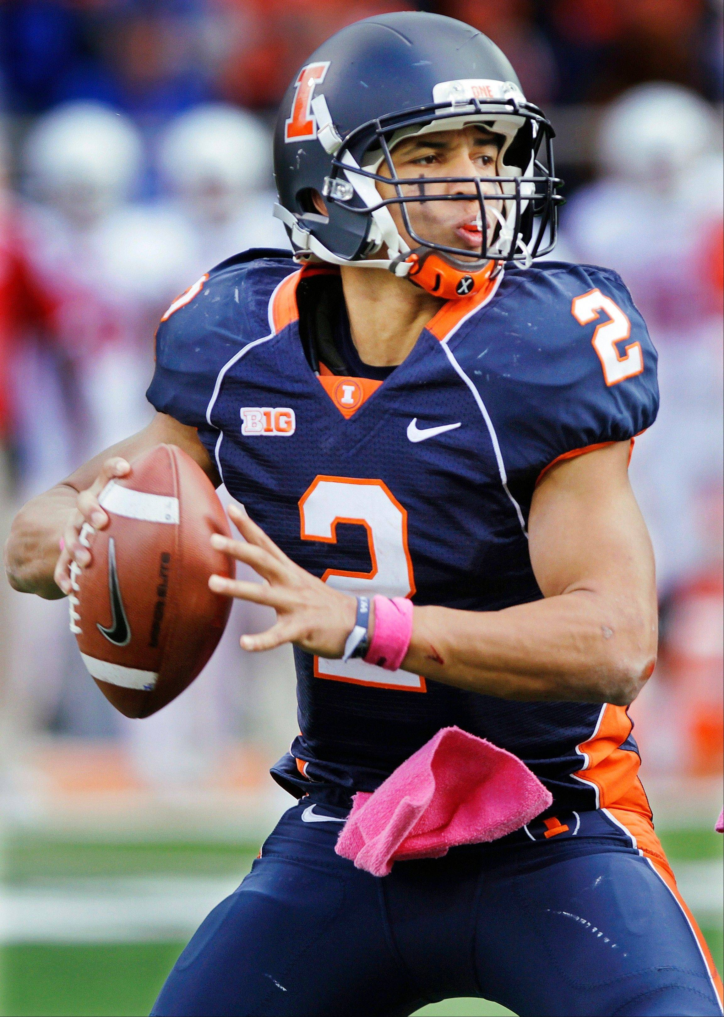 Illinois quarterback Nathan Scheelhaase drops back to pass Saturday during the second half against Indiana in Champaign. Illinois will try to break their five-game losing streak on the road Saturday against Ohio State.