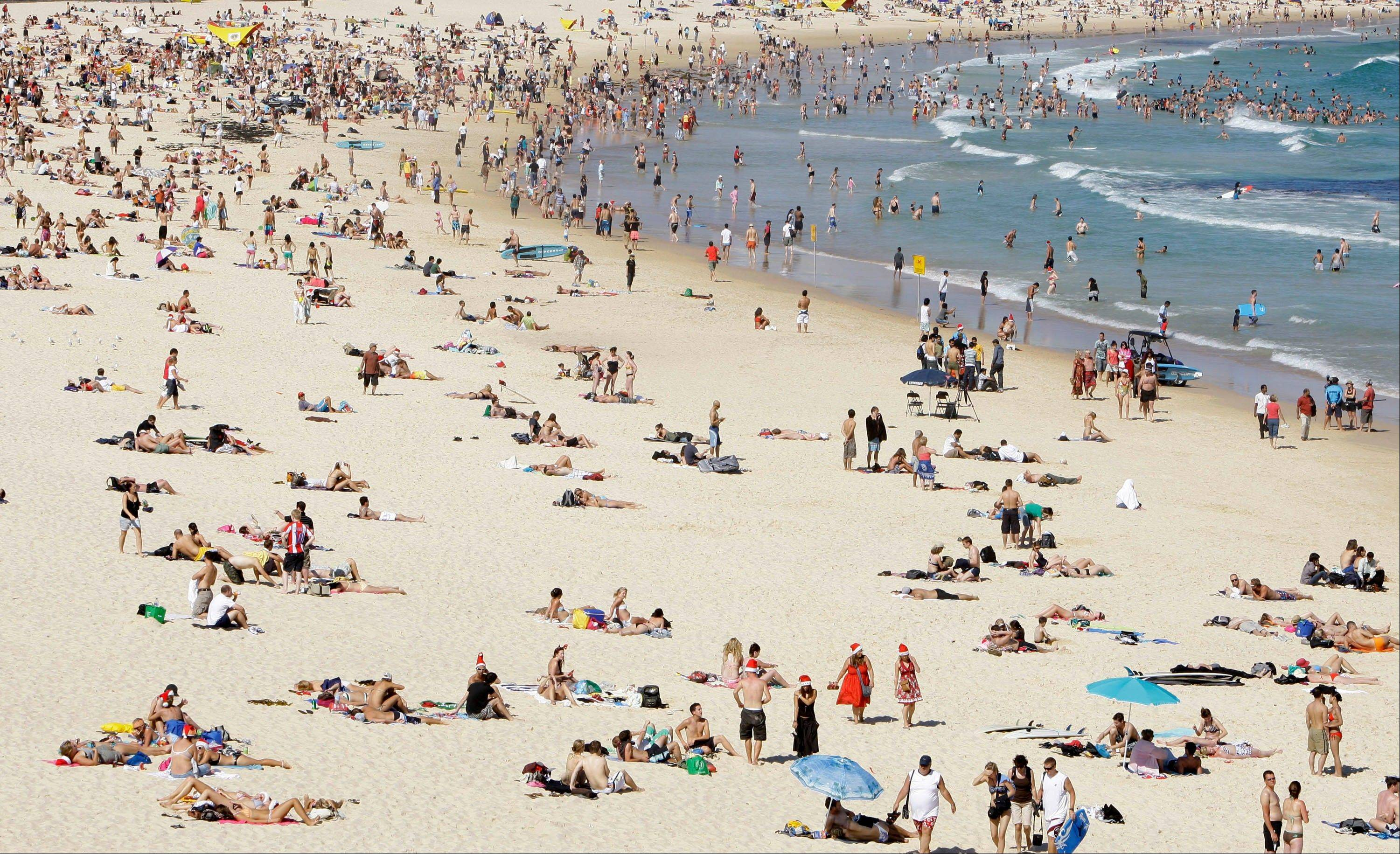 People gather on Bondi Beach in Sydney, Australia. Bondi is the best-known Sydney beach, attracting surfers, sunbathers and more than a few local eccentrics.