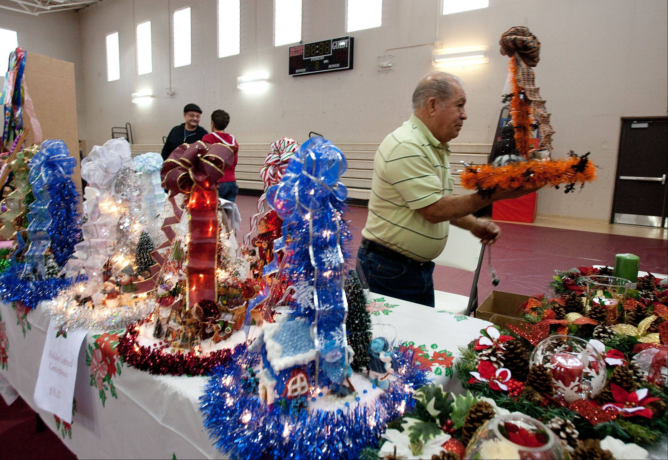 Manuel Guzman displays lighted holiday centerpieces Saturday during the annual Lombard Christmas Mart. Guzman's display was at Sacred Heart Church, one of several Lombard churches participating in the Christmas Mart.
