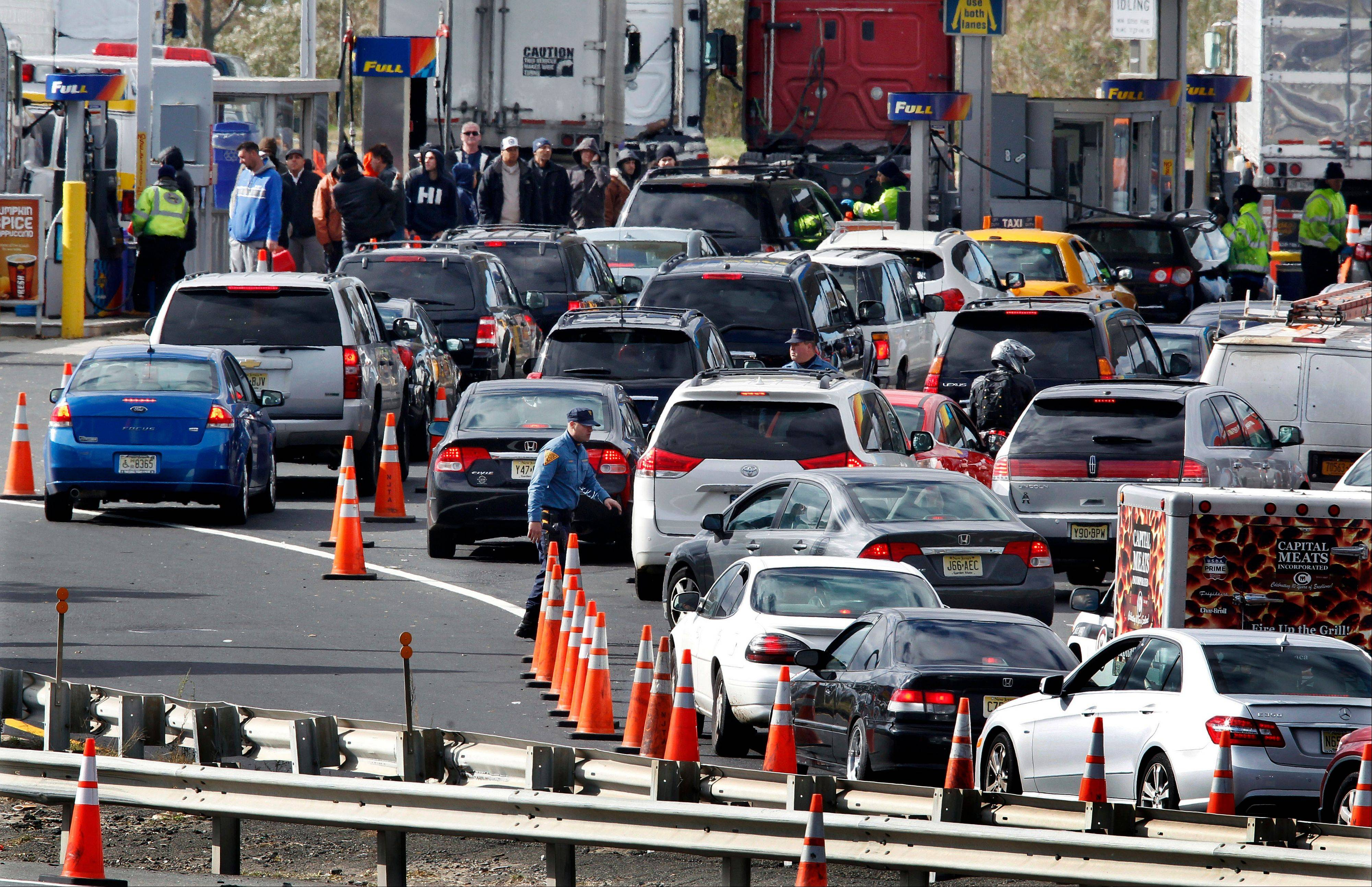 New Jersey state troopers keep order Saturday as motorists line up to purchase gasoline at the Thomas A. Edison service area on the New Jersey Turnpike.