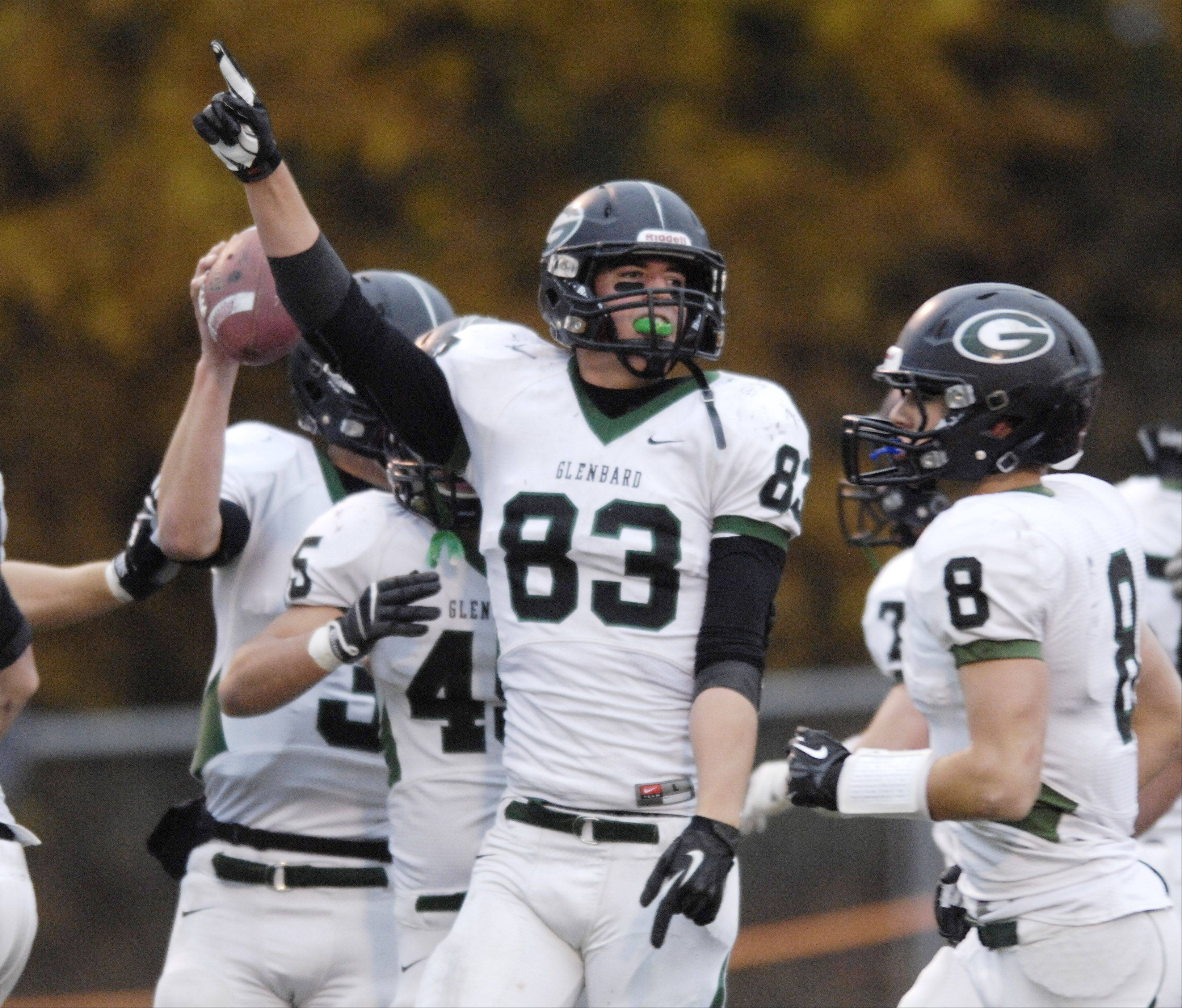 Glenbard West�s Nathan Marcus celebrates a touchdown against Libertyville Saturday.