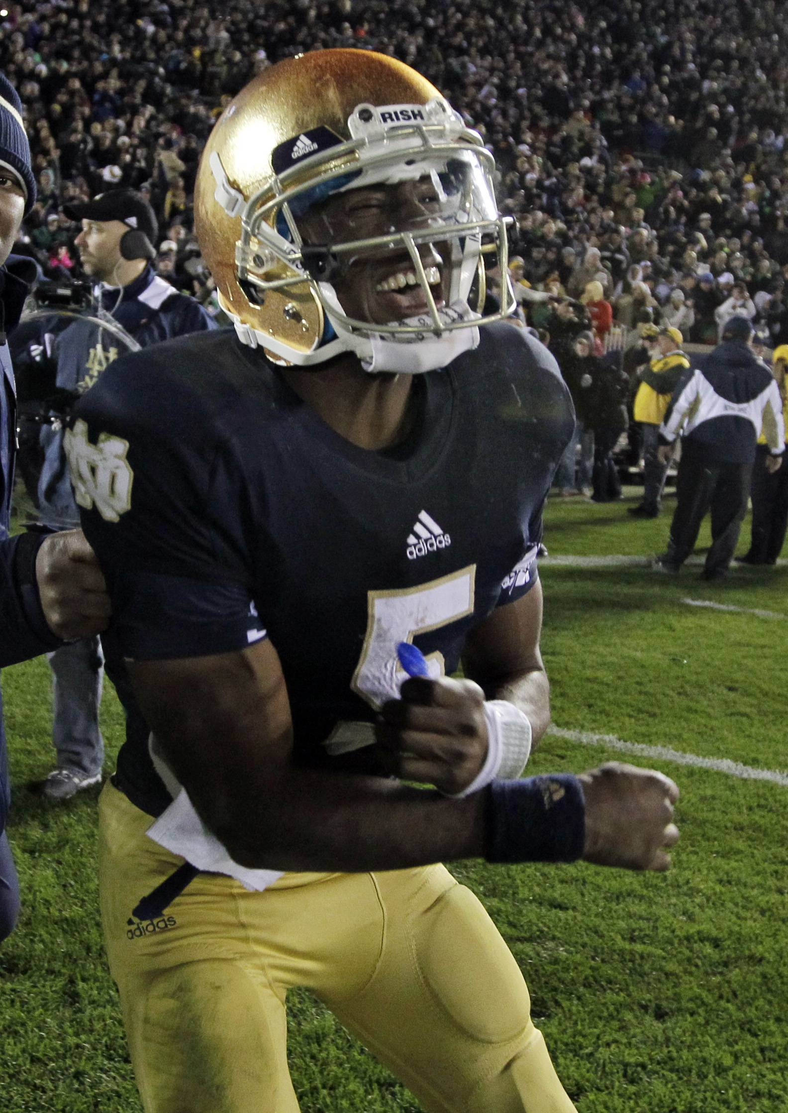 Notre Dame quarterback Everett Golson celebrates Saturday after scoring the game-winning touchdown in the third overtime against Pittsburgh in South Bend, Ind. The Irish defeated Pittsburgh 29-26 in triple overtime.