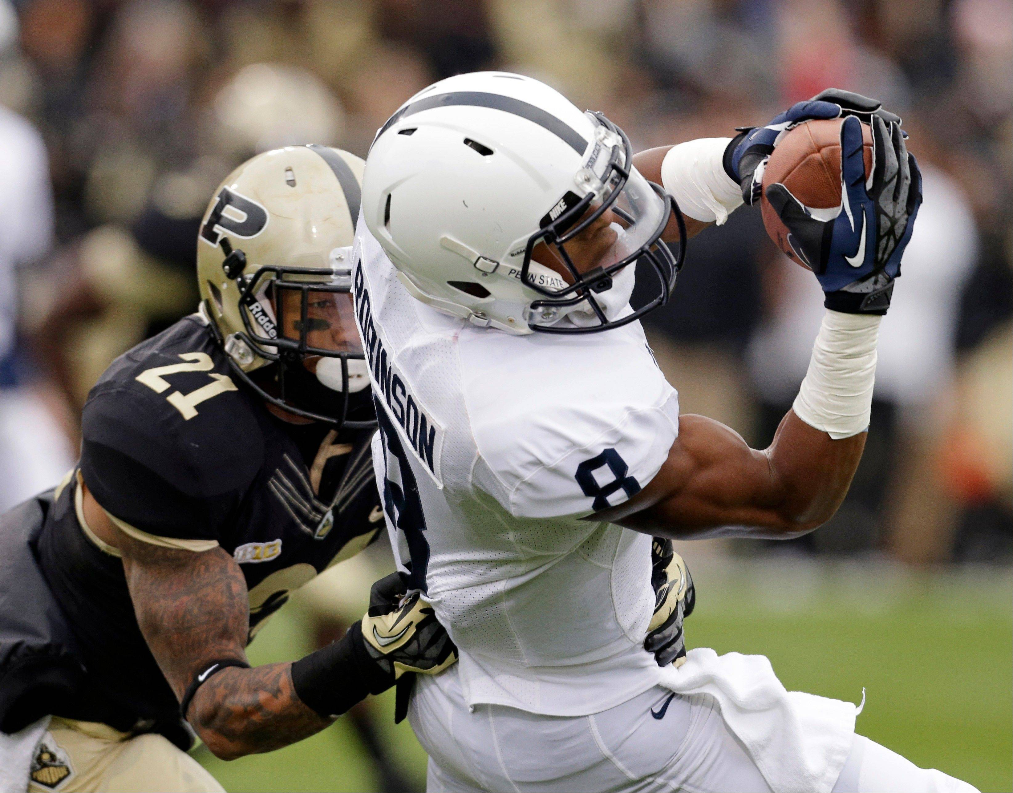 Penn State wide receiver Allen Robinson makes a catch against Purdue cornerback Ricardo Allen Saturday during the first half in West Lafayette, Ind.